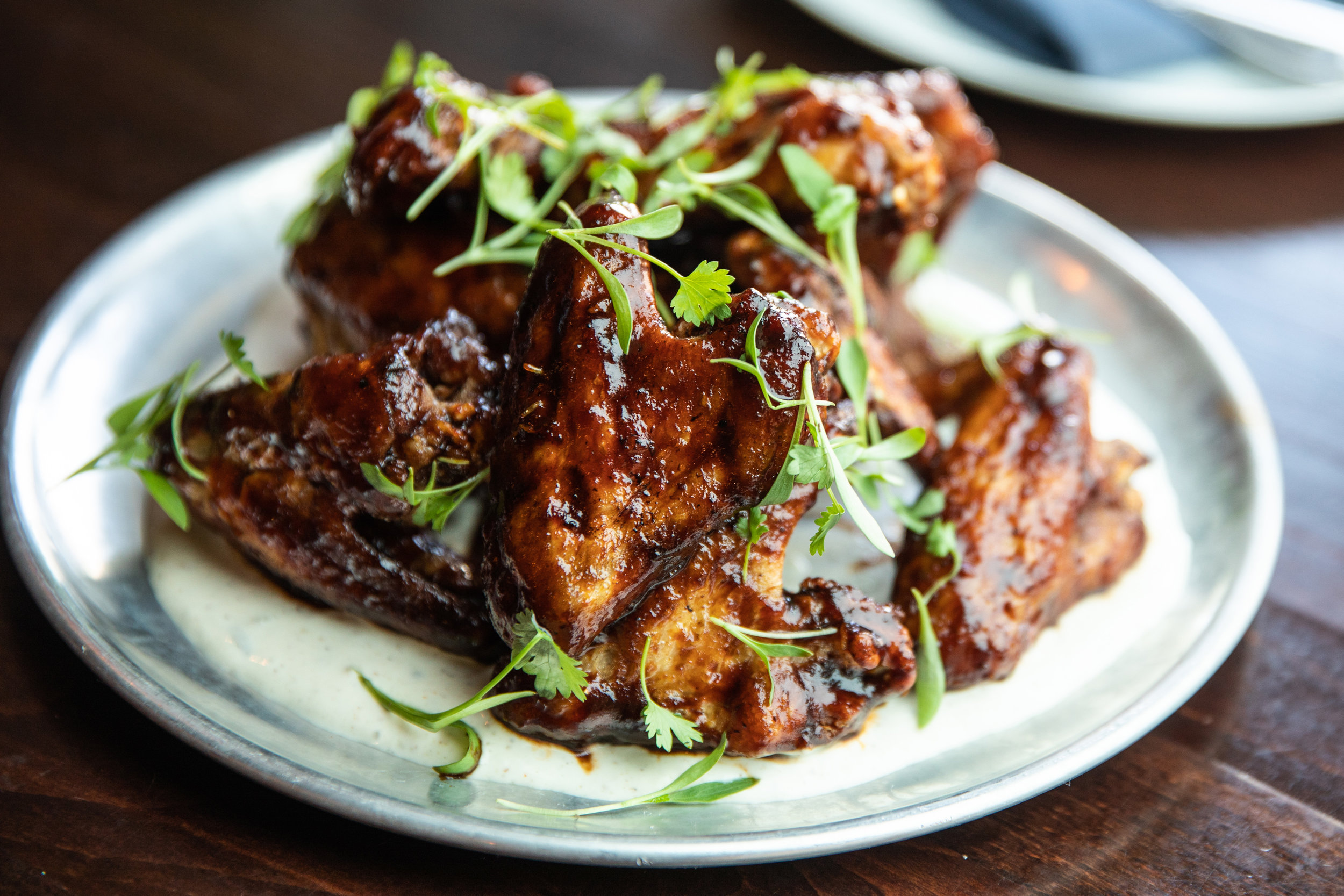 CRISPY BRAISED DR PEPPER WINGS - 10pc whole wings w/ pomegranate-habanero bbq, lime crem &, cilantro