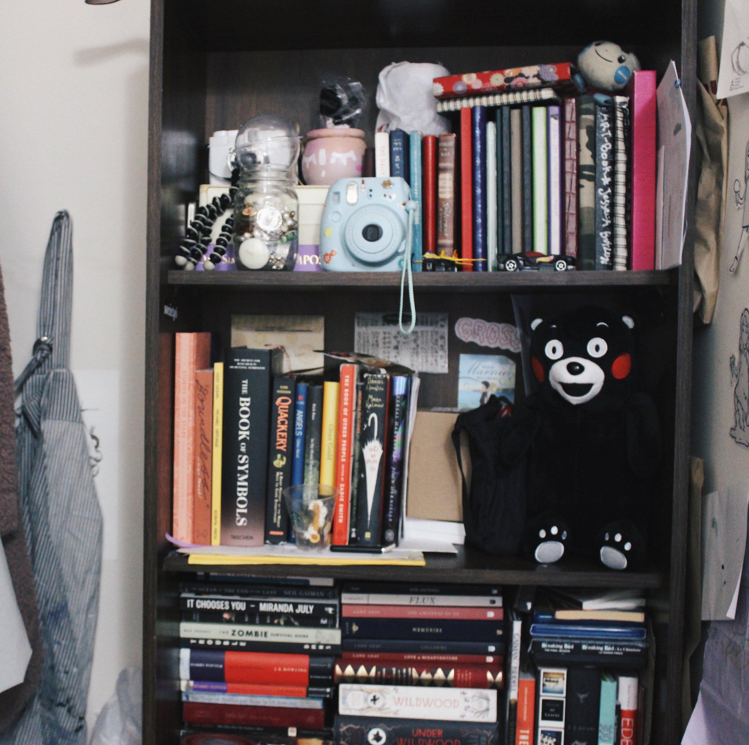BONUS: My book shelf and one of my favourite characters, Kumamon.