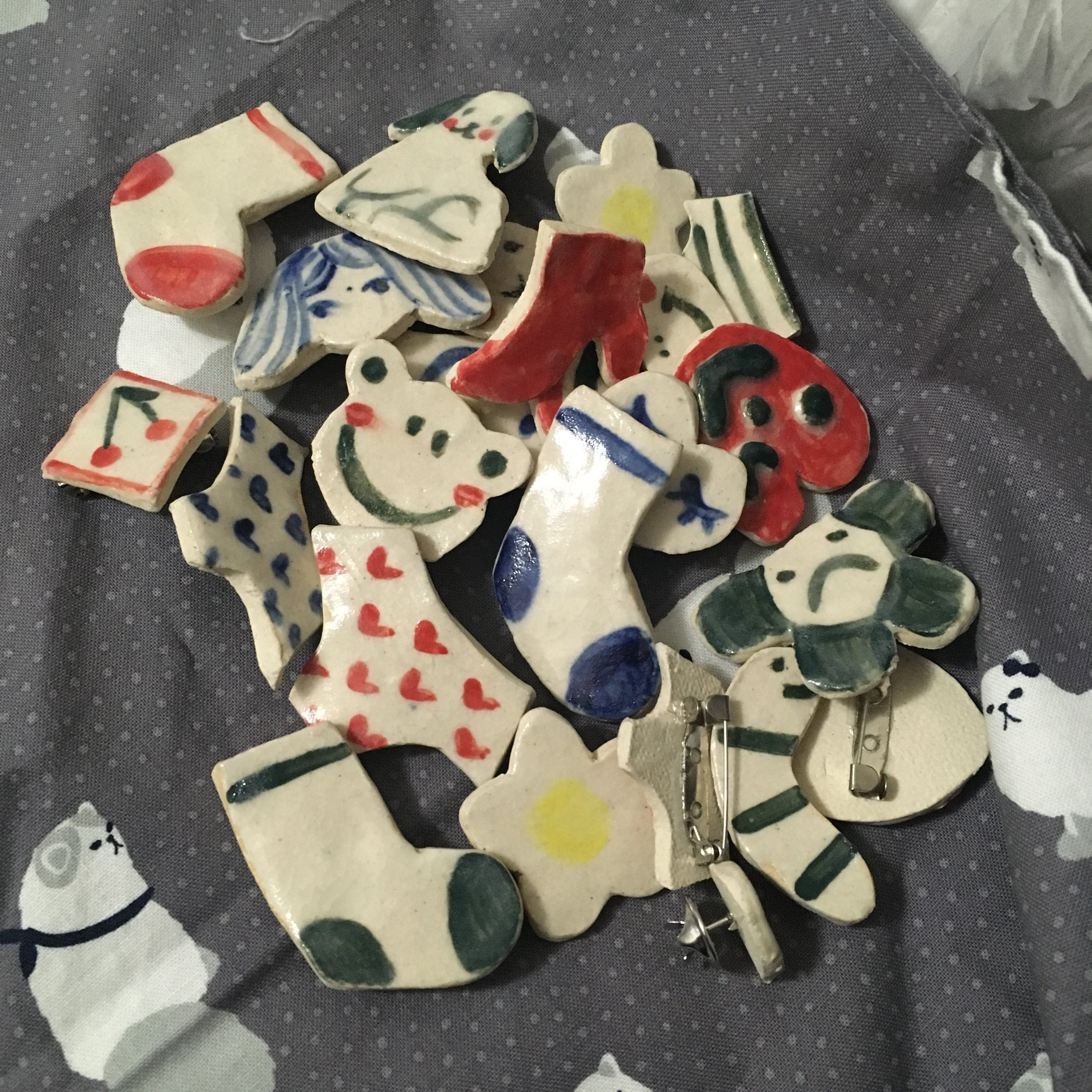 lots of ceramic pins I made that didn't make it for artist alley but did debut at xpace's holiday zine and market fair