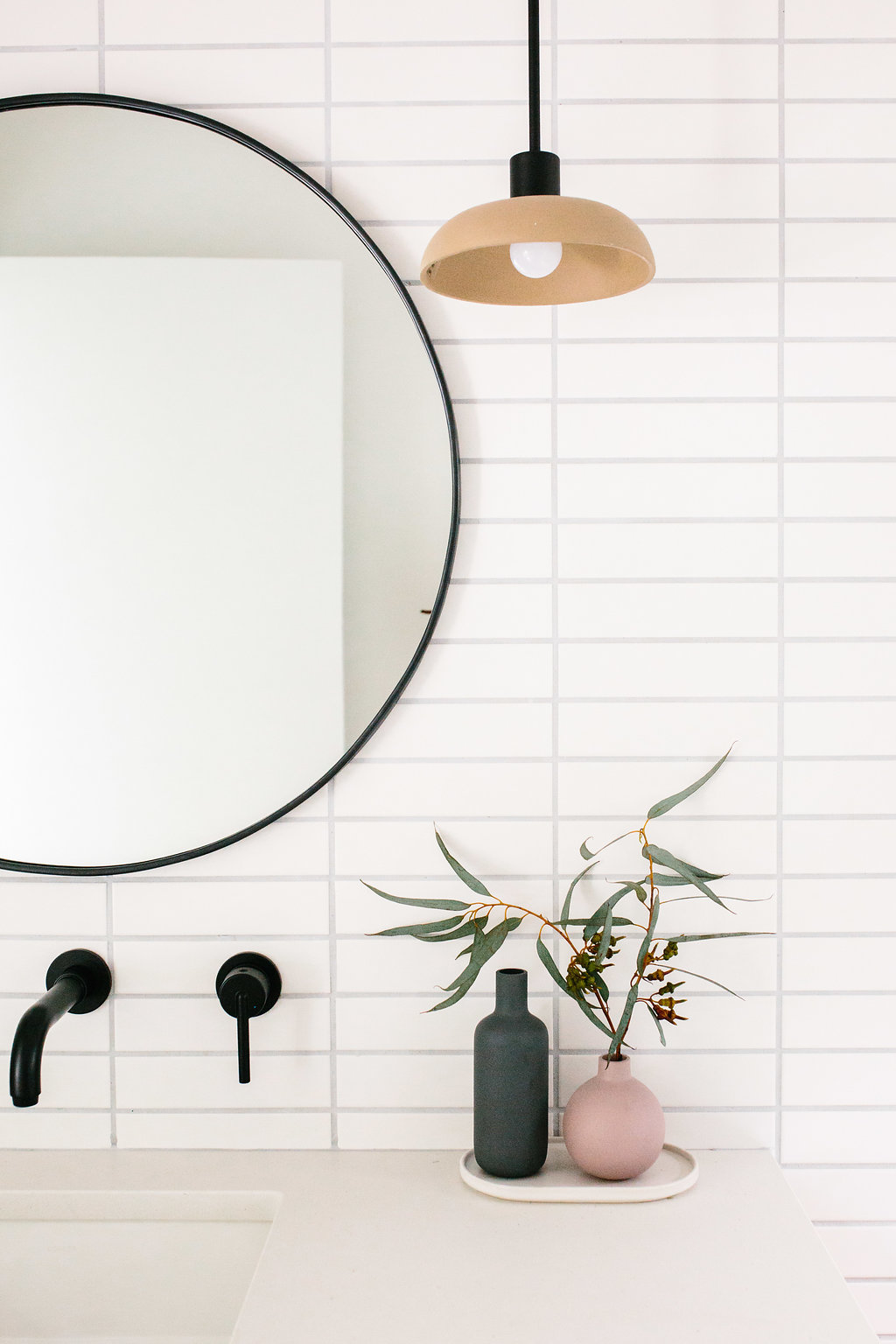 This shows the pendant version instead of the sconce but I do so love the way it effortless steals the show here in  Jen of The Effortless Chic  bathroom redo.