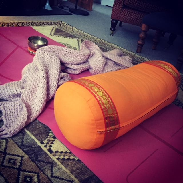 yoga bolster - an invaluable prop for yin and restorative yoga!