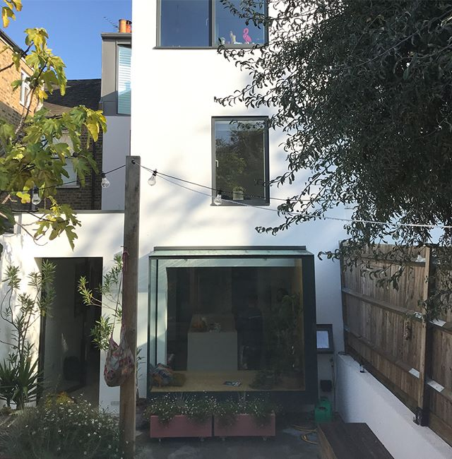 Extension, loft, structural glass window seat and pivot door still looking good a year on. #se4 #construction #zinc #structuralglass #structuralglazing #windowseat