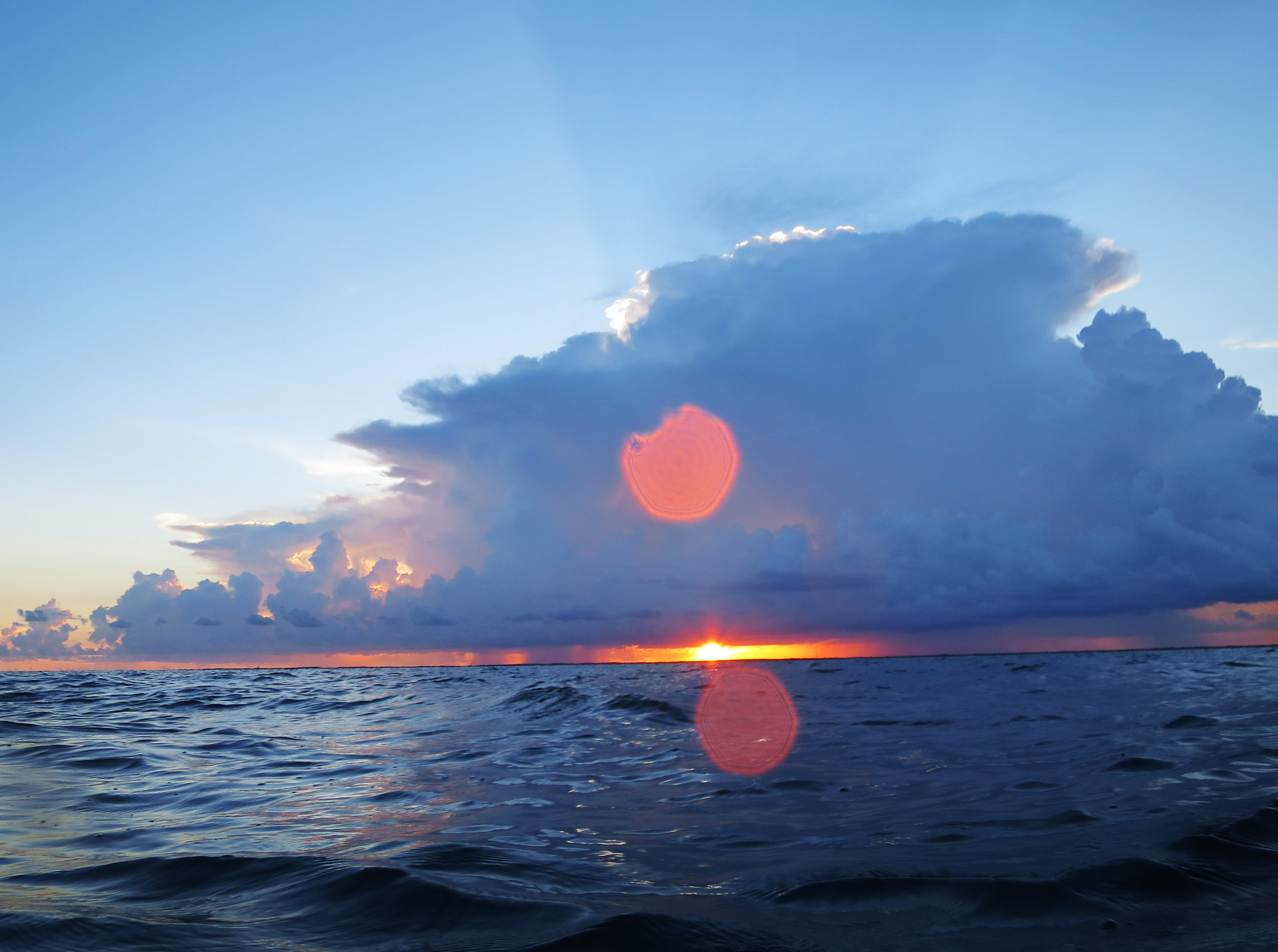The sun sets over John Pennekamp Coral Reef State Park in Key Largo, FL as we wait for coral spawning to begin.