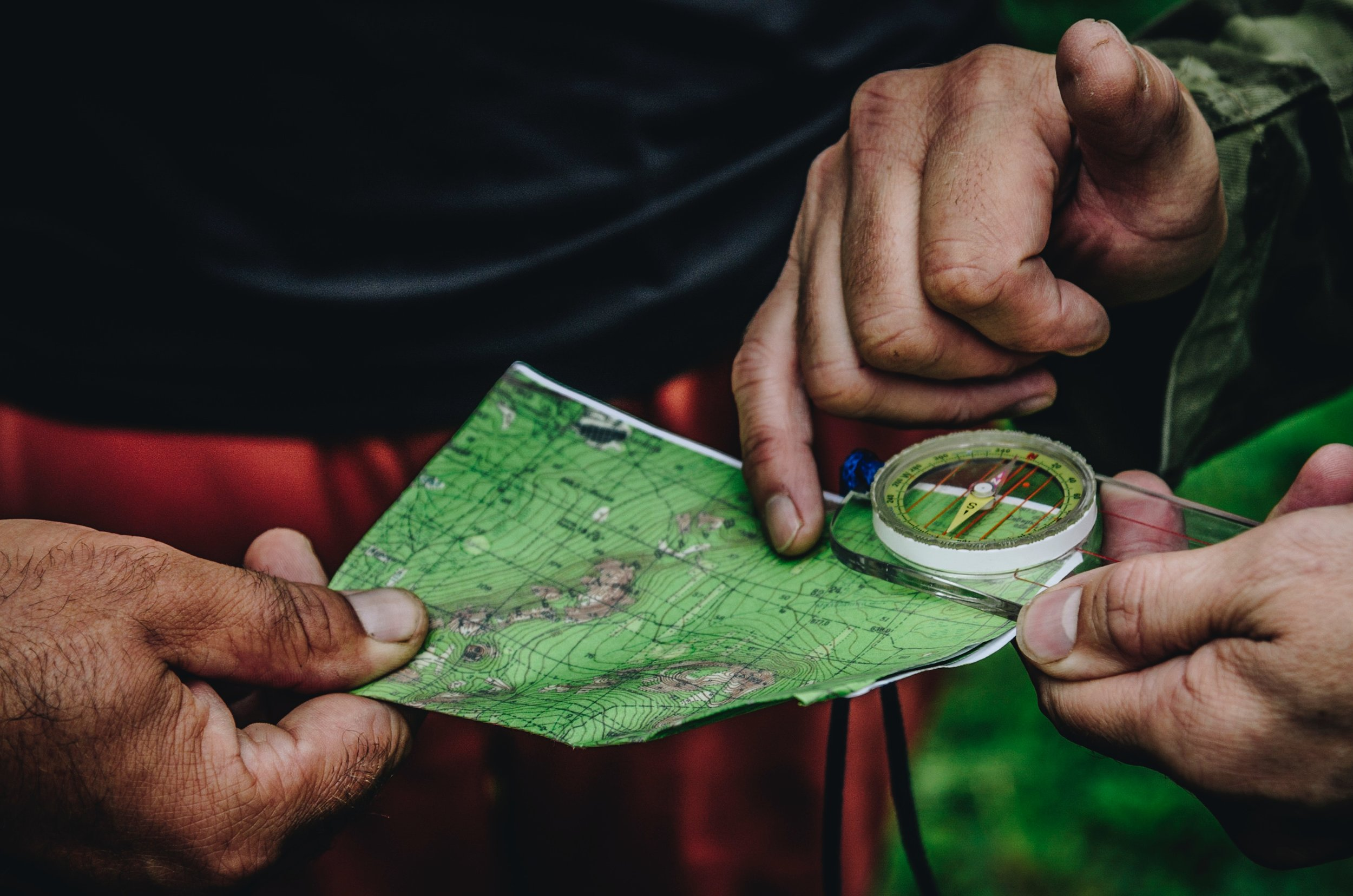 hands-with-map-and-compass-photo