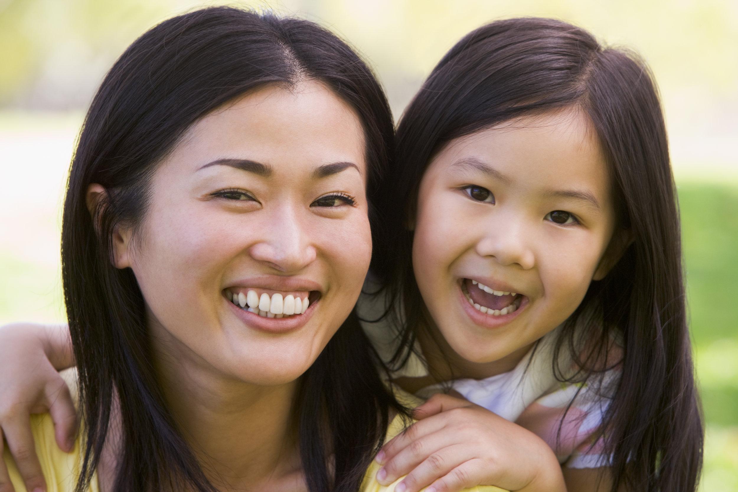 woman-and-young-girl-outdoors-embracing-and-smiling_rYZRXYCSj.jpg