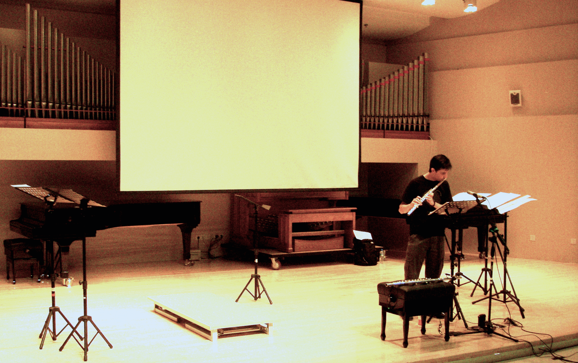 MusicaAcoustica Series 2011 : Symposium for Flute and Electronics with Orlando Cela, at Beijing Central Conservatory of Music, September 2011, Beijing, China.  World premiere  of the work   the broken is the beautiful ...