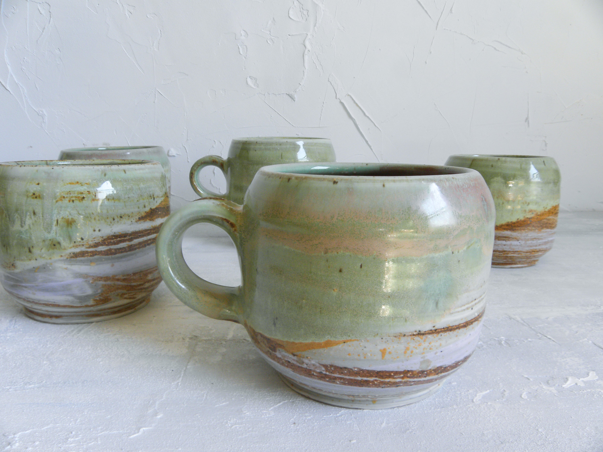 I love the peek of caramel on these mugs, where the glaze meets the bare striated clay.