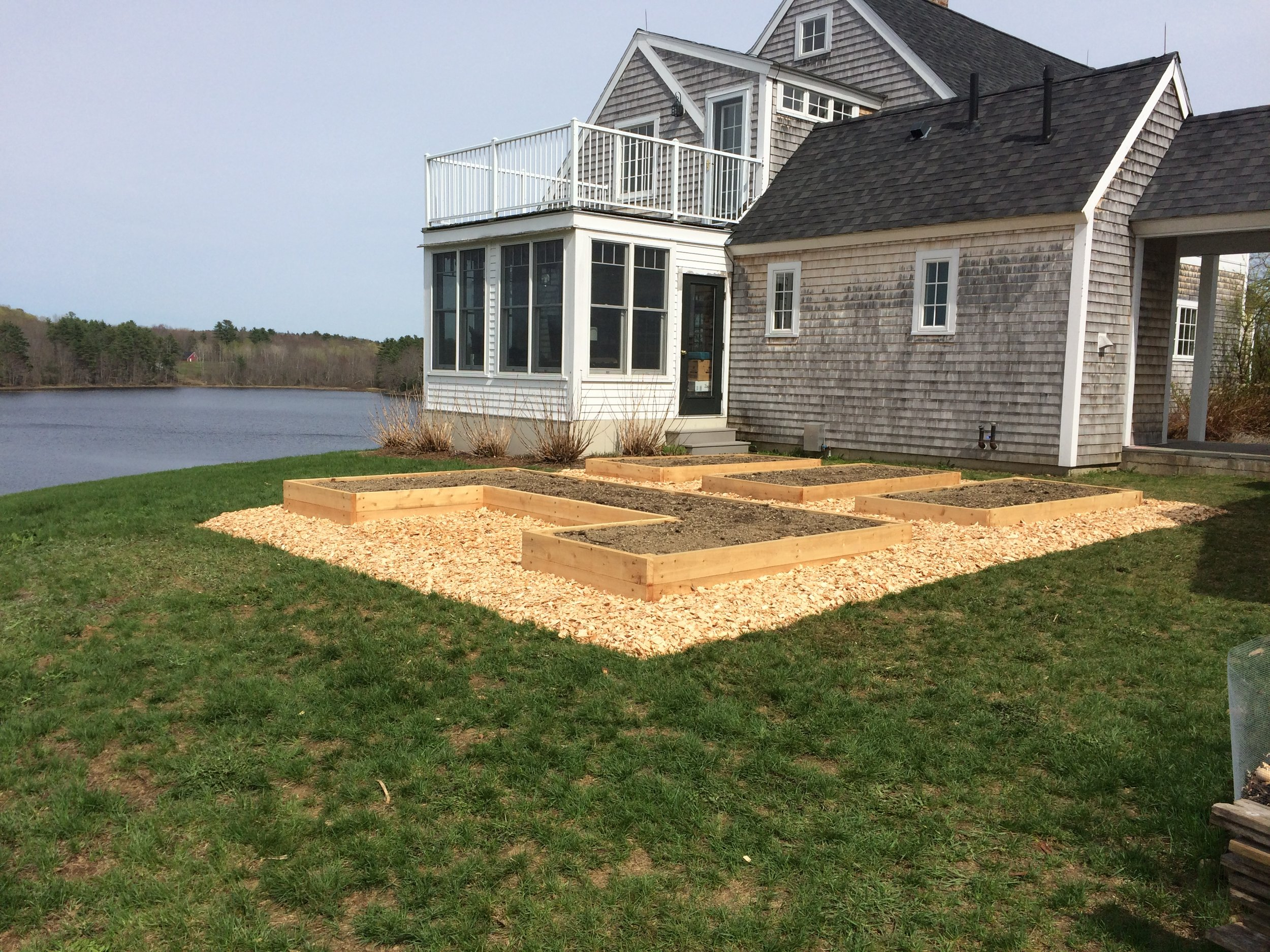 After (6 custom cedar raised beds for lakeside home)