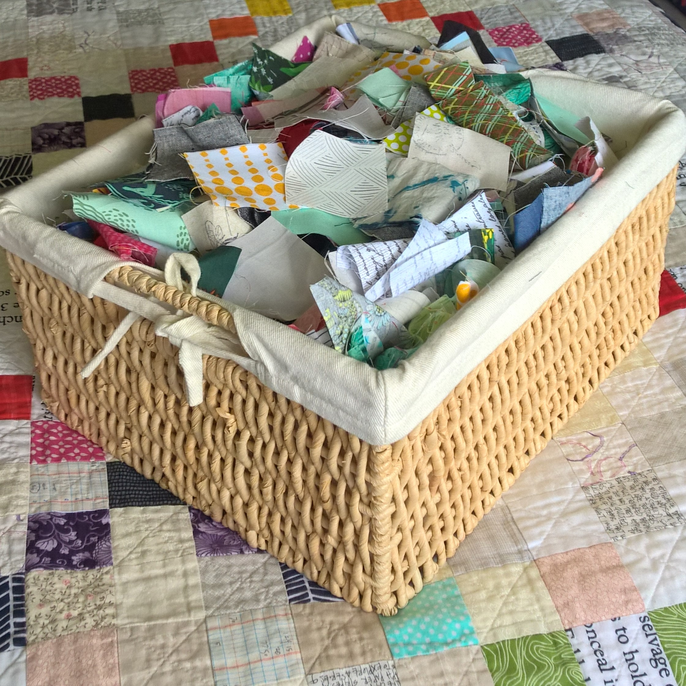 """My scrap basket dedicated to 2.5"""" squares. Basket measures 14""""x12""""x7"""" and no matter how many scrap projects I do, I feel like a barely make a dent in this pile!"""