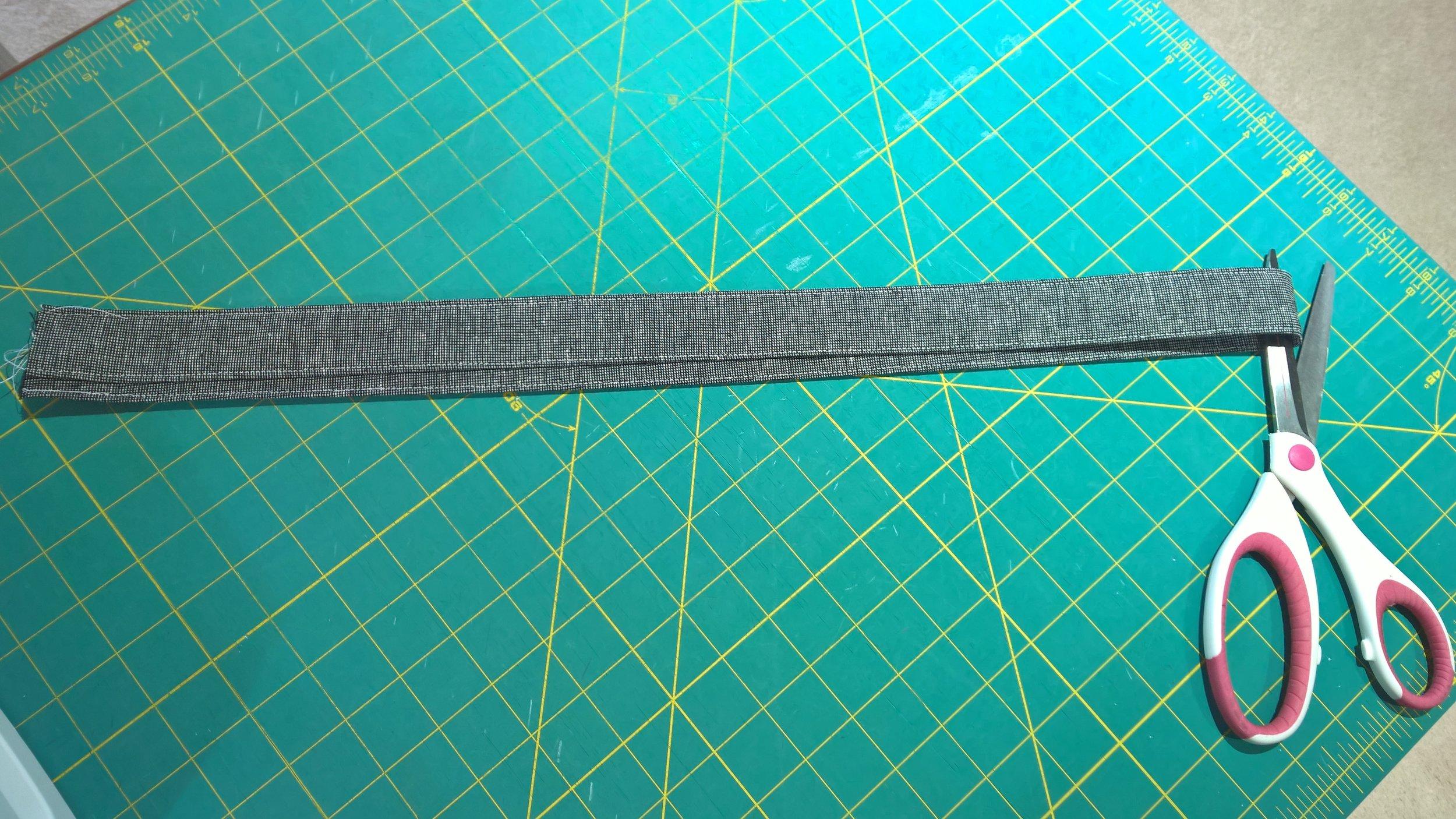 Cutting long handle in half.