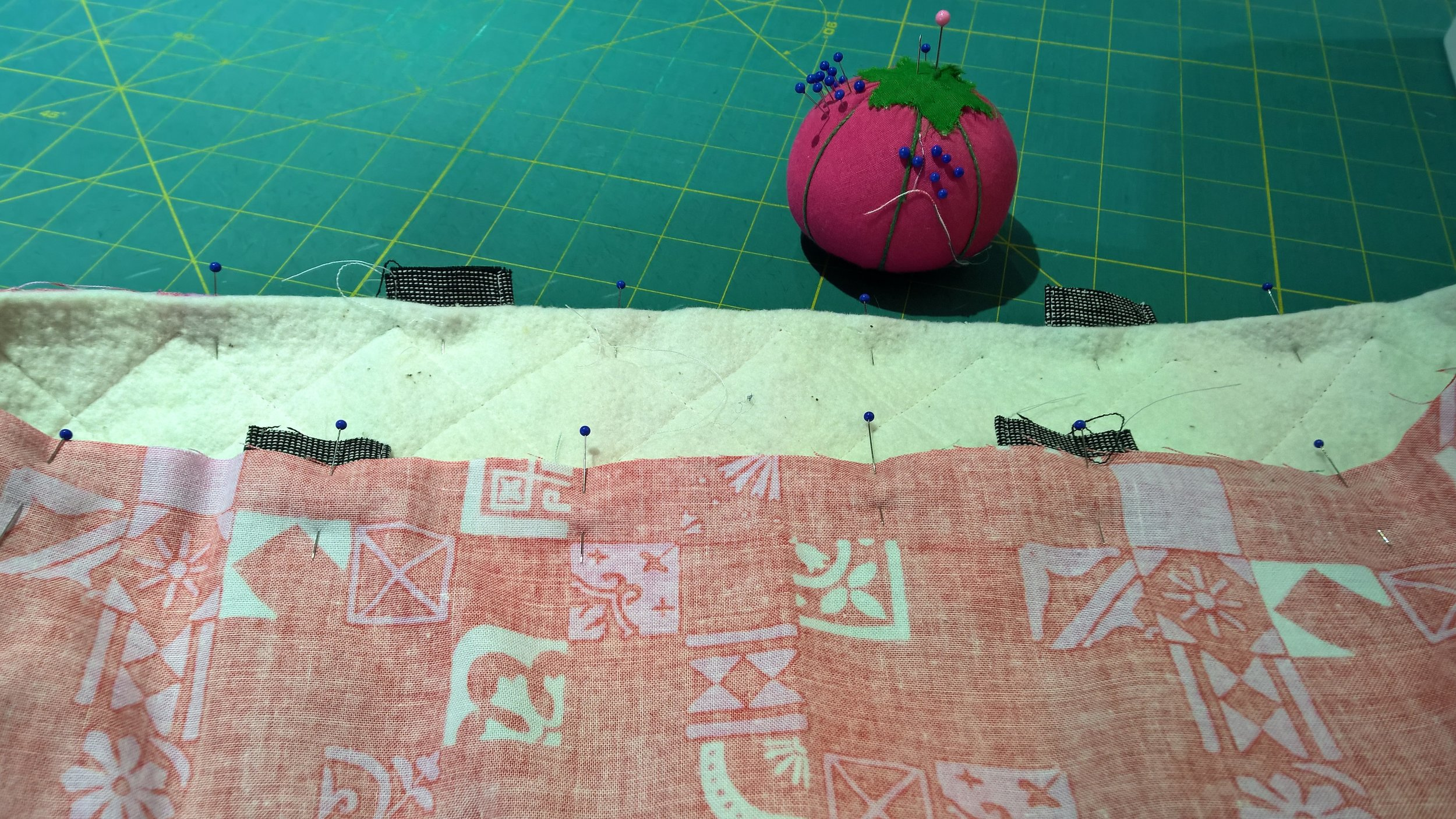 Handles tucked between patchwork and lining.