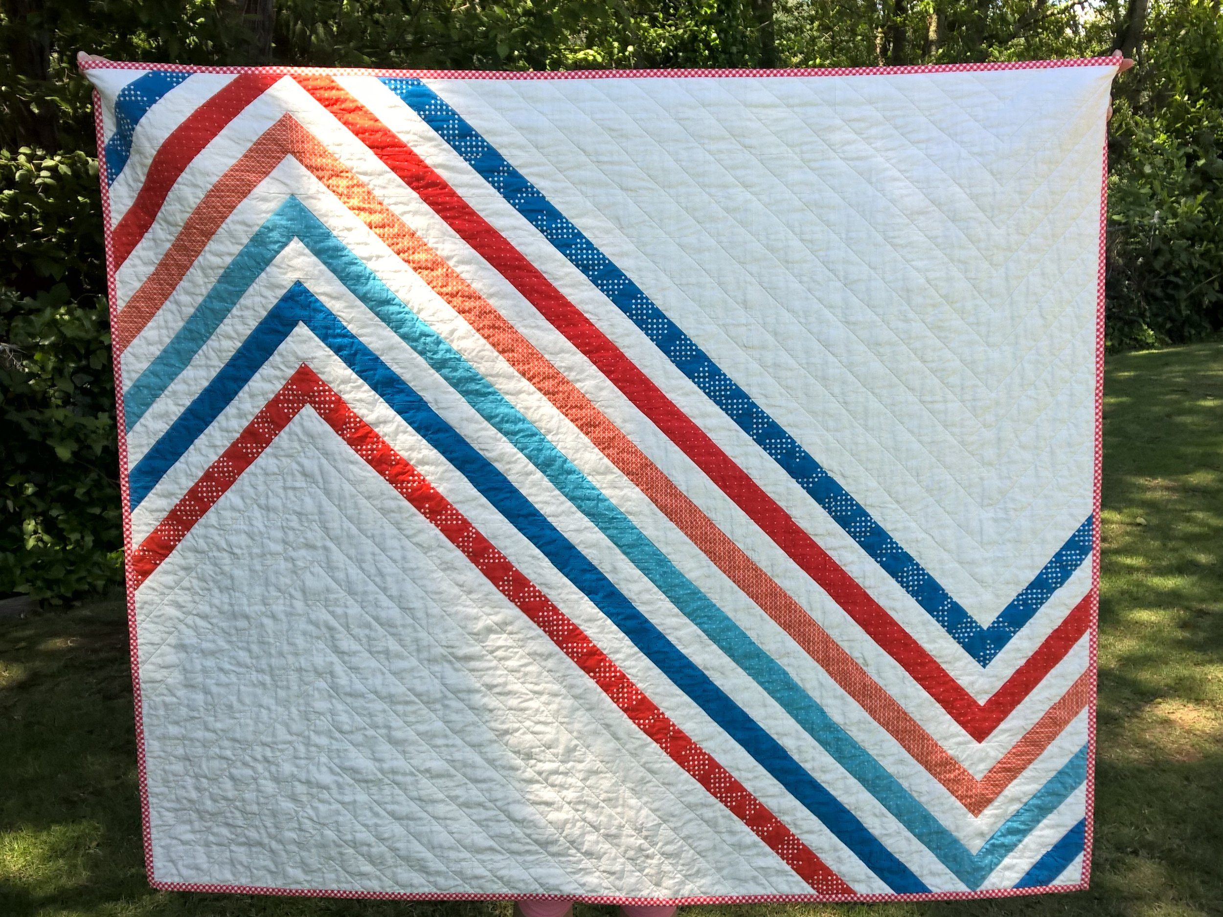 Special thanks to darling daughter for holding the quilt for a photo op!