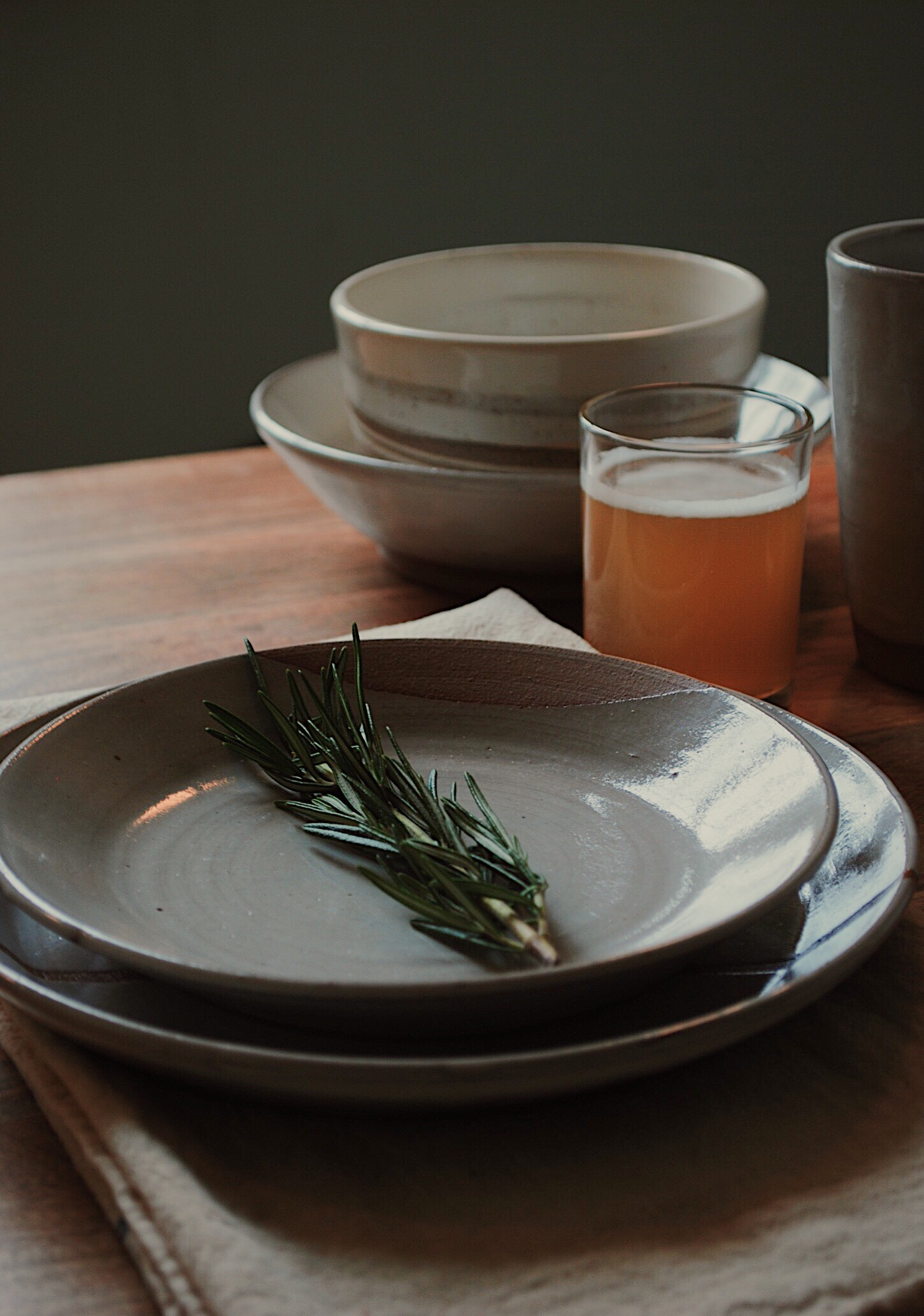 Photo by Ellen Buley - A custom set of plates and misc. dishes from Doghouse Pottery