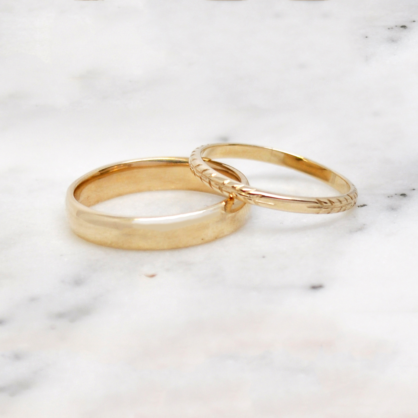 10k custom wedding bands with intricate hand engraving