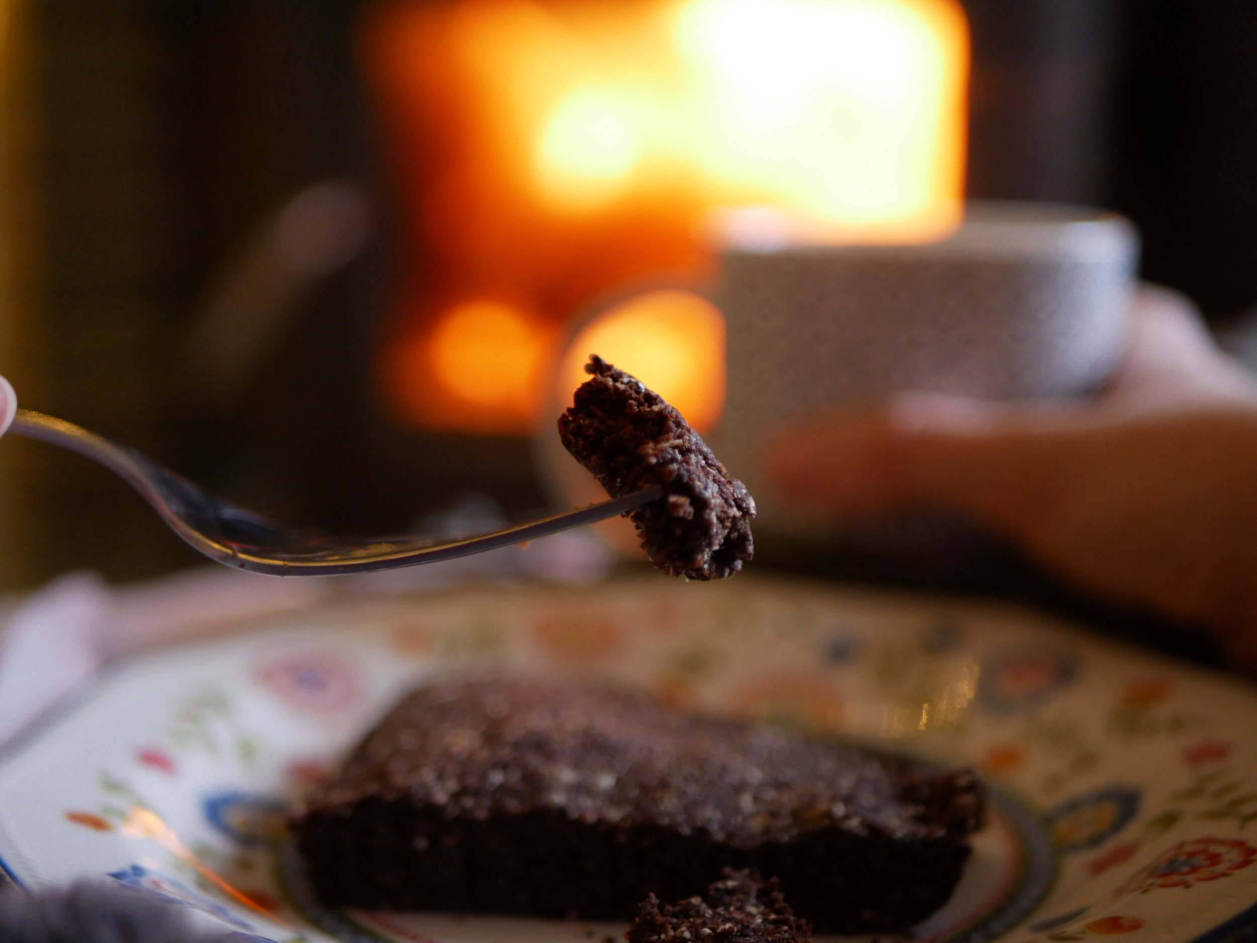 brownie on a fork in front of fire