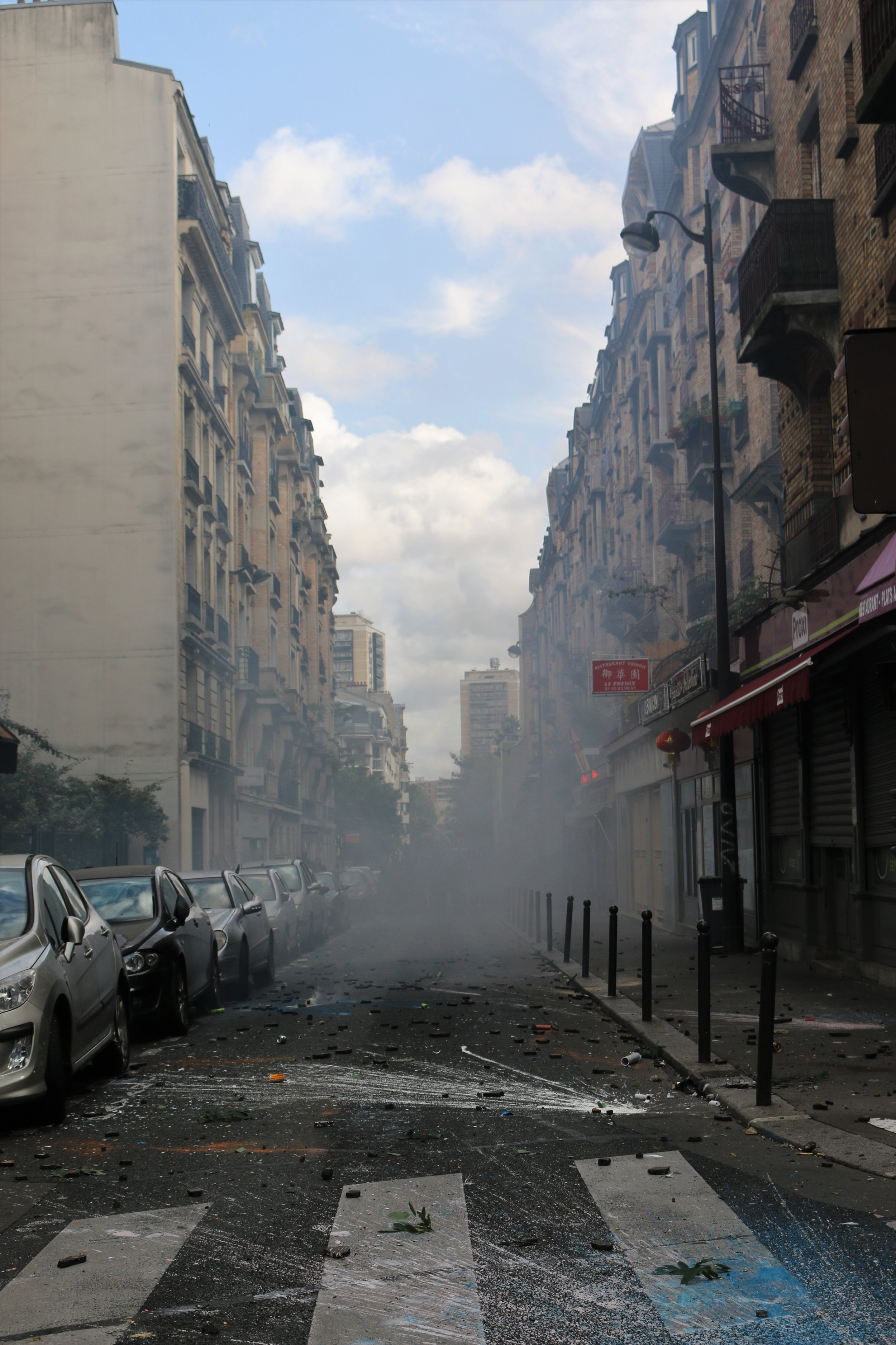 Paris, France. Police retreat in a haze of tear gas as they come under attack from protesters