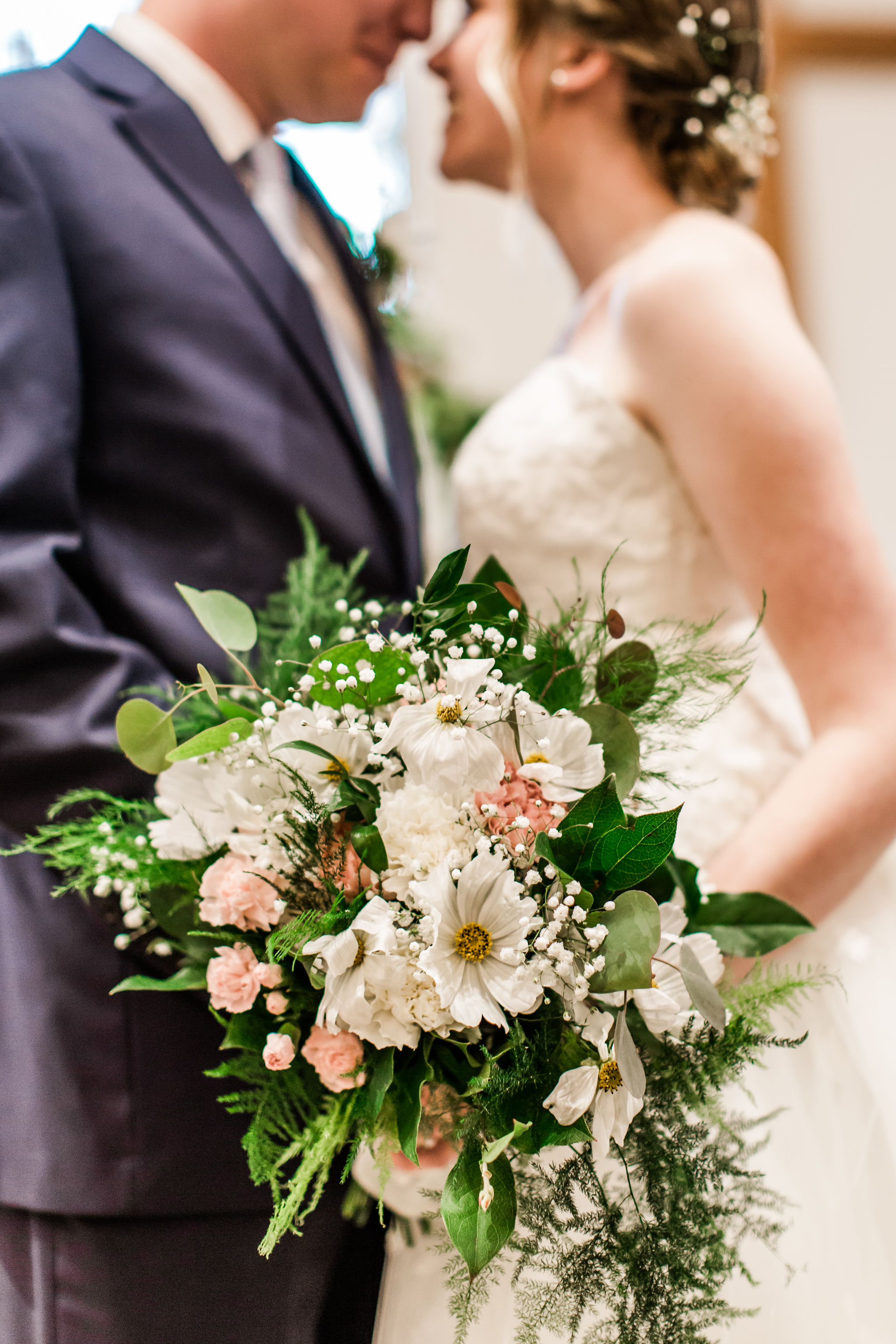 Abby's Grandmother made all of the floral arrangements used in their wedding. The white cosmos flowers seen only in Abby's bouquet were grown from seed this spring specifically for Abby's wedding bouquet.