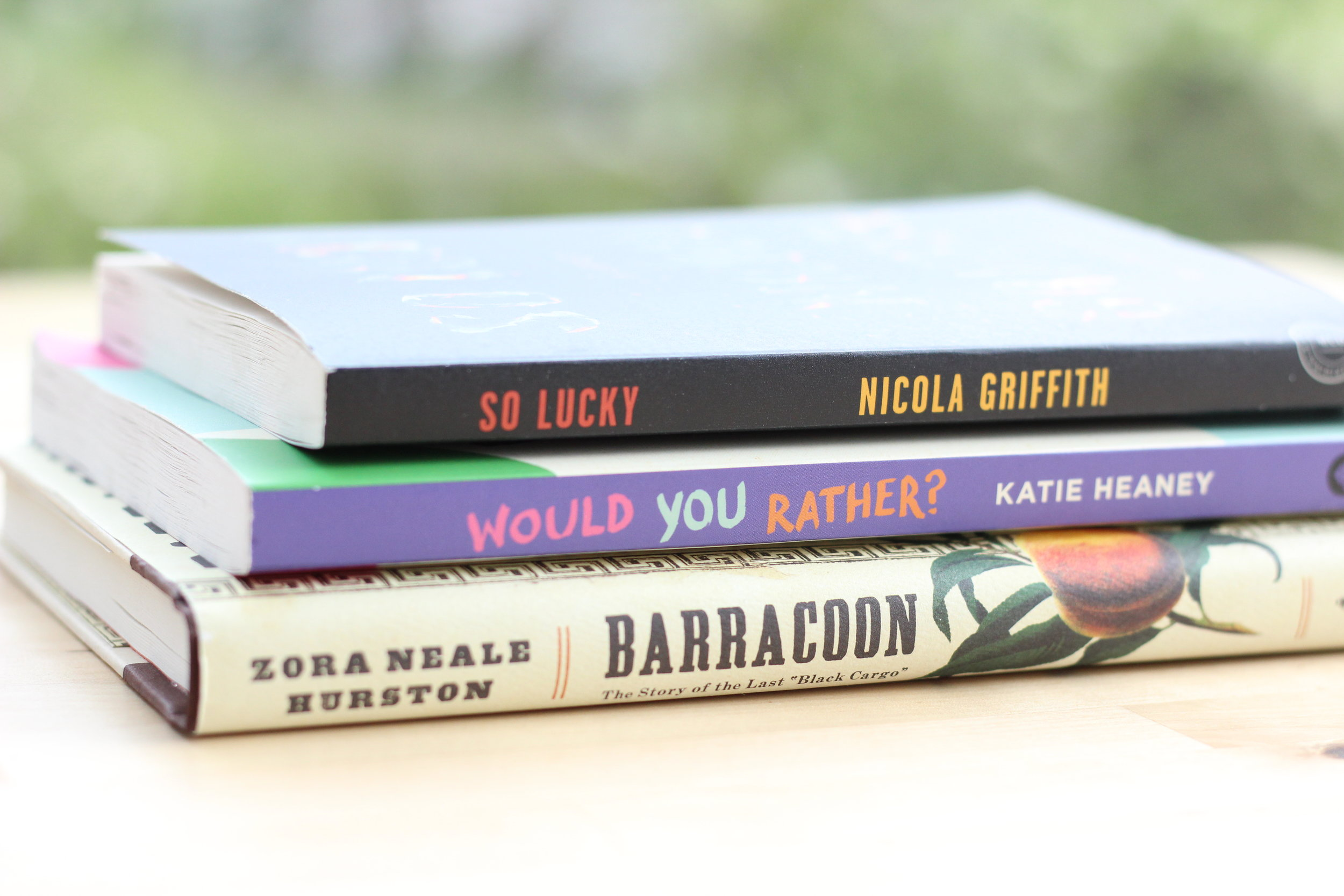 May reads book stack.jpg