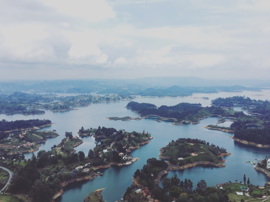 What started as a dam-turned-man-made-lake quickly became a top tourist attraction from Medellín, even in spite of the 500+ steps it takes to get here  #piedradelpeñol   #guatape   #medellin   #colombia   #yearoftravel   #solofemaletravel   #travelblog   #pathunwritten