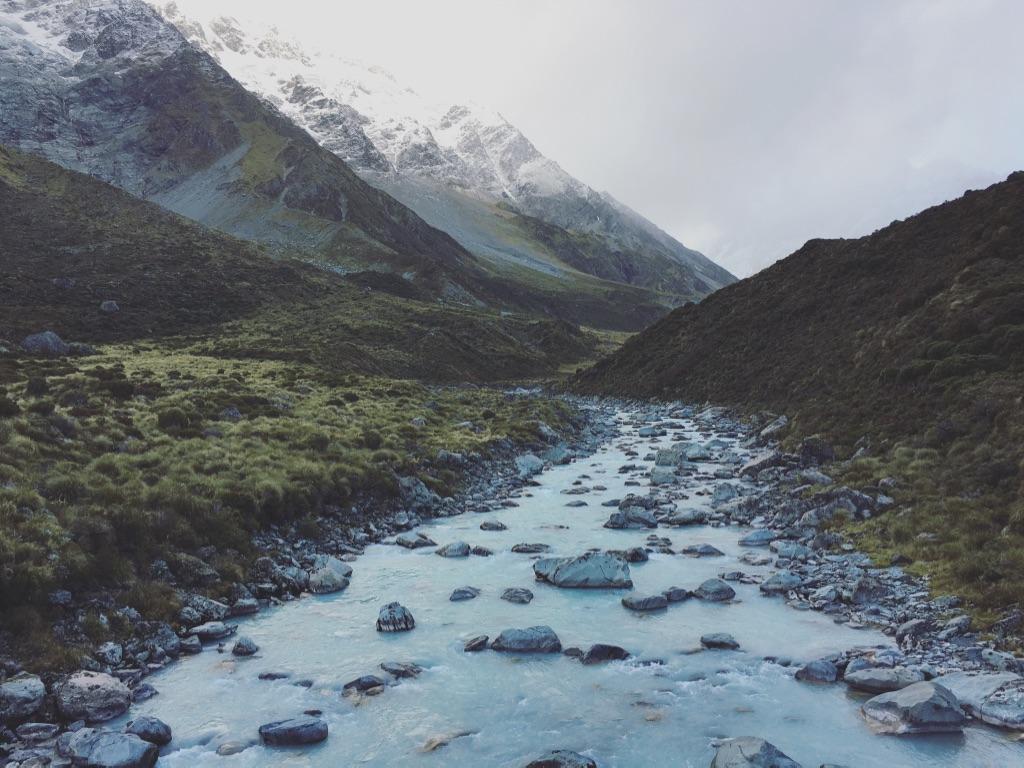 Even when the weather is blue in Mt. Cook, it's still beautiful 🏔🌧 #mtcooknationalpark  #newzealand   #trampingnz  #glaciallake  #naturetravel   #hookervalley  #hookerlake  #hookerglacier   #solofemaletravel  #yearoftravel  #travelblog   #pathunwritten