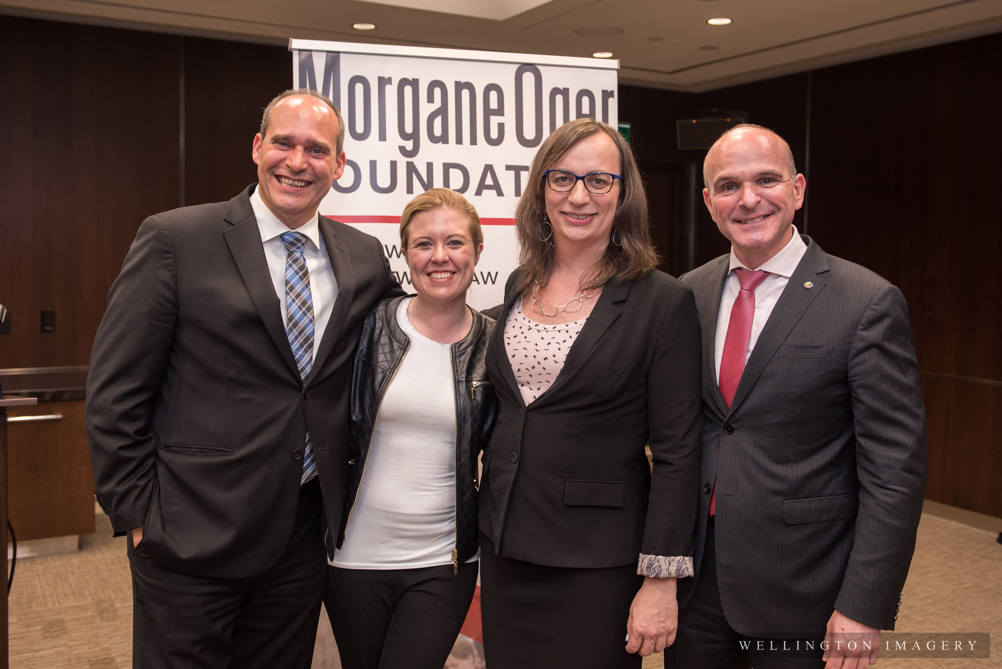 (From the left) NDP House Leader Guy Caron, the Hon.Michelle Rempel, Trans rights activist Morgane Oger, and LGBTQ2 Special Advisor to the Prime Minister Randy Boissonnault pose for a family photo at the May 29 reception for inclusion on Parliament Hill
