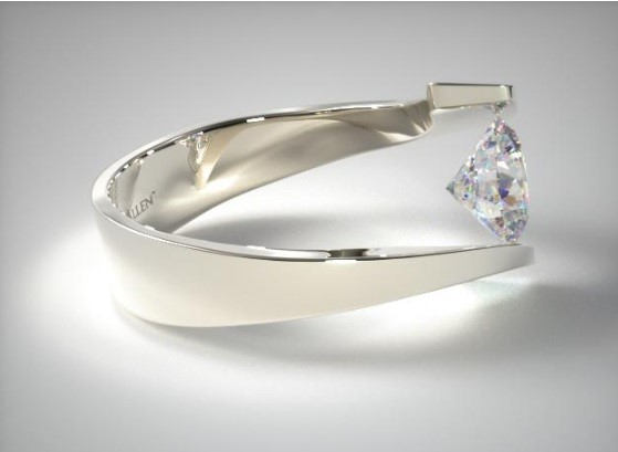 Tension:  A Tension setting holds the diamond between two shanks by pressure. The contact points are grooved to provide greater security. The net result is a diamond that appears suspended within the ring. In this example from James Allen, you can truly see how the settings gives the effect that the diamond is floating between the two shanks.
