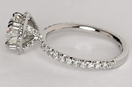 Pavé:  A Pavé setting paves numerous diamonds tightly together providing a dazzling effect. Keep in mind that this setting can be very difficult to resize. In this example from Blue Nile you can see the Pavé effect originating from the shanks and rising up through the thick prongs and culminating in the Pavé halo sorrounding the central diamond.