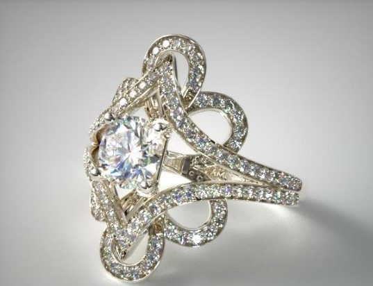 Shank:  A Shank style mount refers to a ring where the shank (the actual sides of the ring) split apart. The result is a very unique ring that, while not popular, is very attention grabbing. The above James Allen ring utilizes this technique as the shank splits into a floral design enveloping the central solitaire.