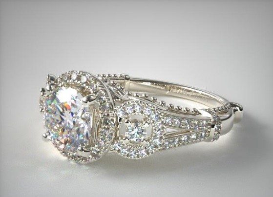 Antique:  An antique setting is used to mimic an older style and can be influenced by different periods. The setting can combine multiple elements, such as Pavé, Filigree, Cluster and Milgrain to form complex mounts whose artwork is as much a focal point of the ring as the diamond itself. This James Allen piece fuses several elements to create a magnificent ring.