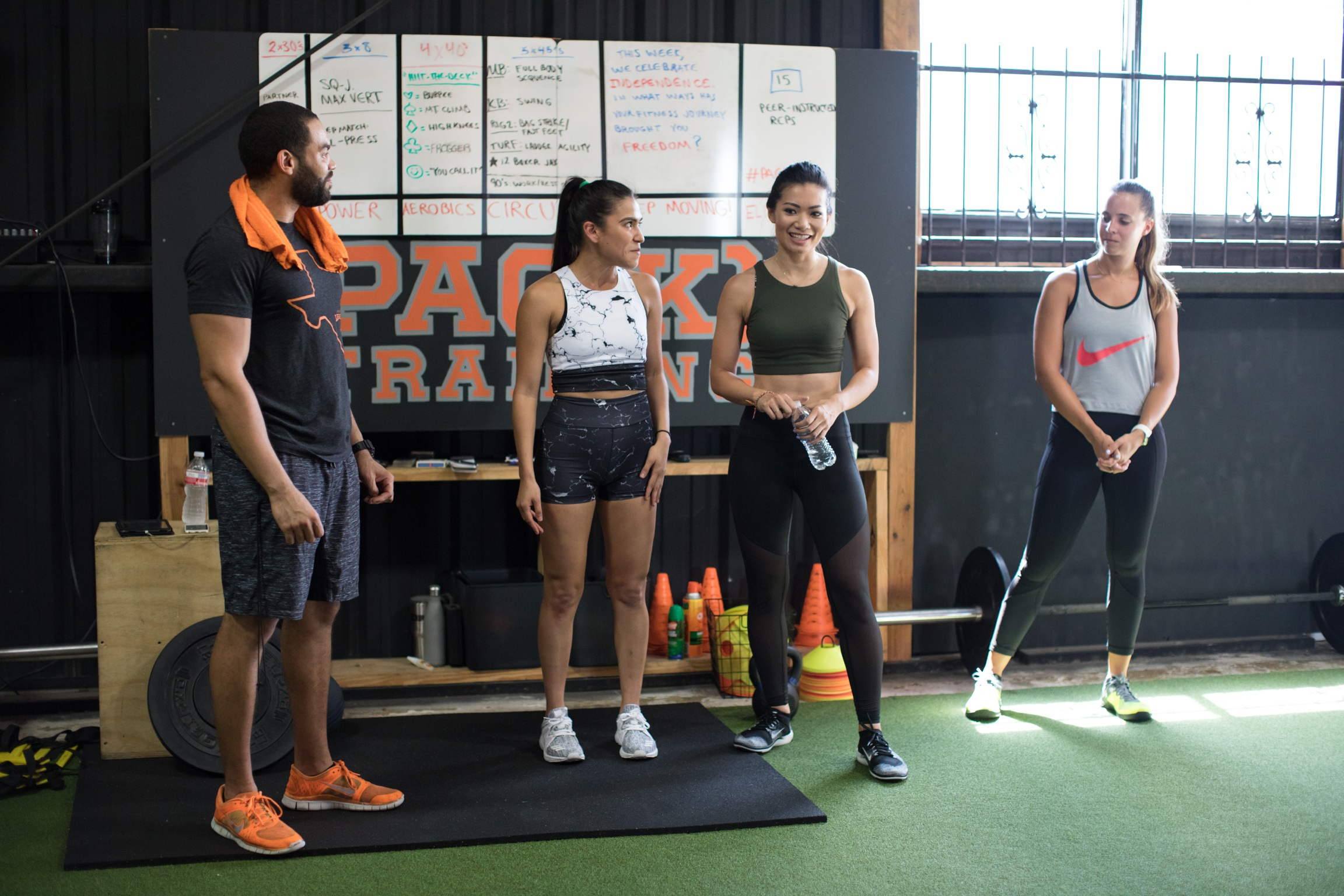 Starla and I introducing Terry, owner of The League, and Marlee, before they kick our butts with a PAC(K) Training class, which combines strength training and conditioning exercises!