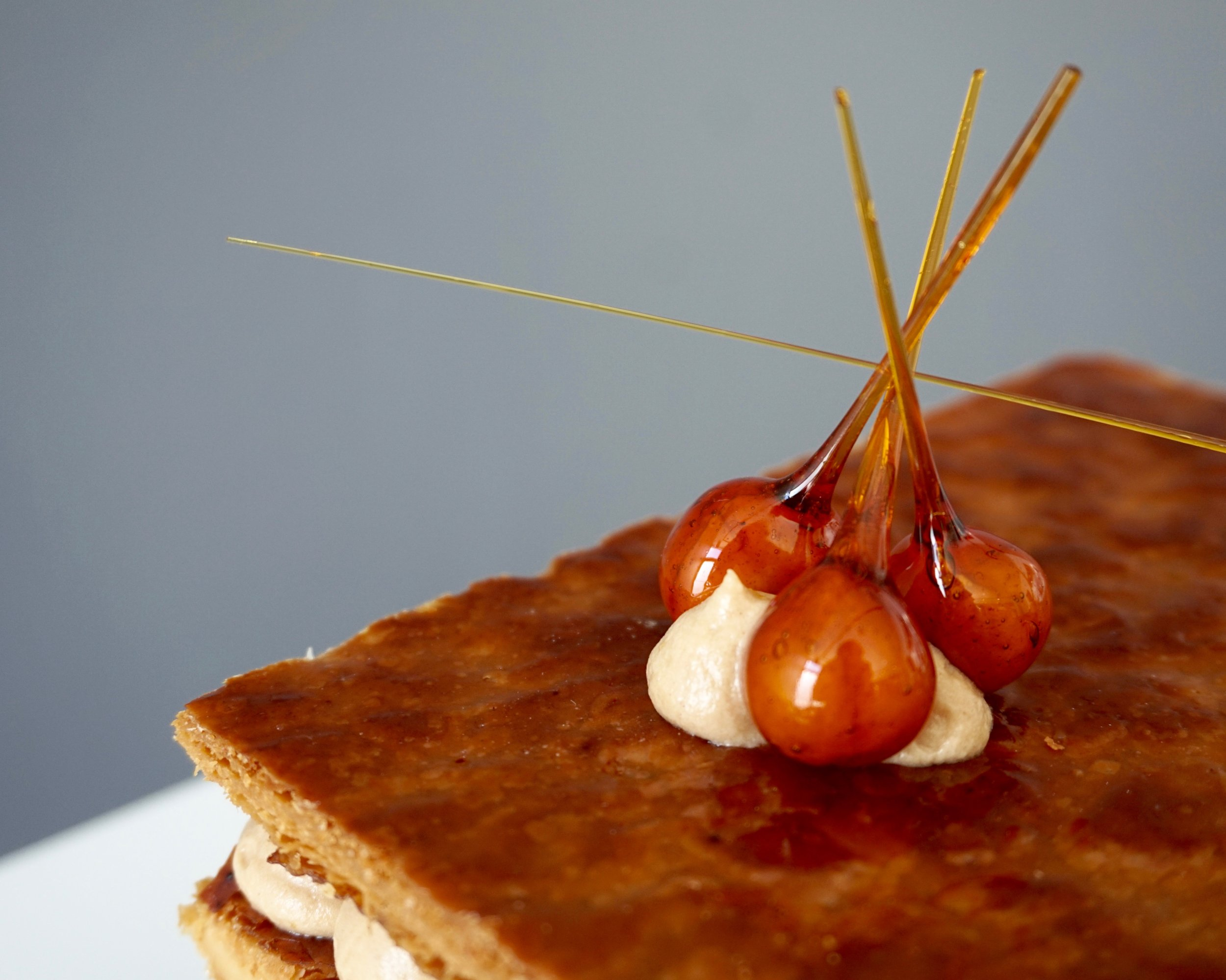 Hazelnuts on millefeuille made by Gusta Cooking Studio