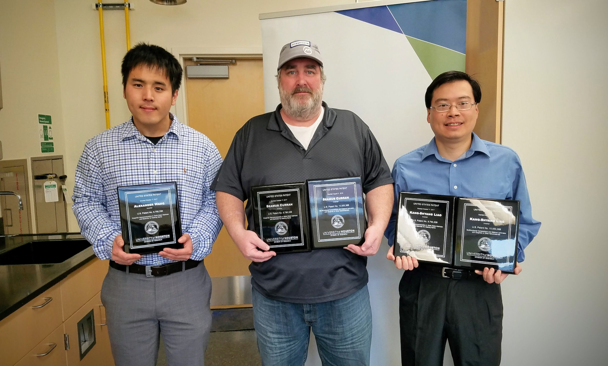 Starting from left COO (Mr. Alex Wang), CEO (Prof. Shay Curran), and CTO (Dr. Shawn Liao) holding their respective patent awards.