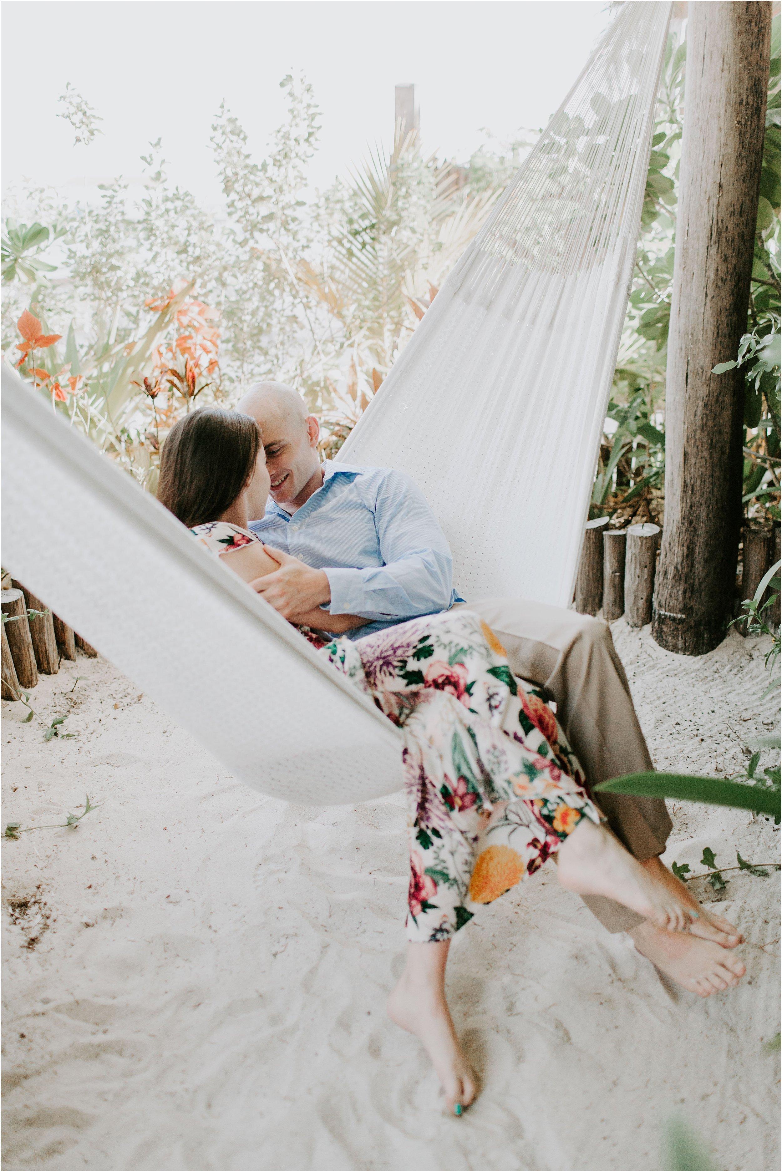 A couple snuggles in a hammock in Belize.