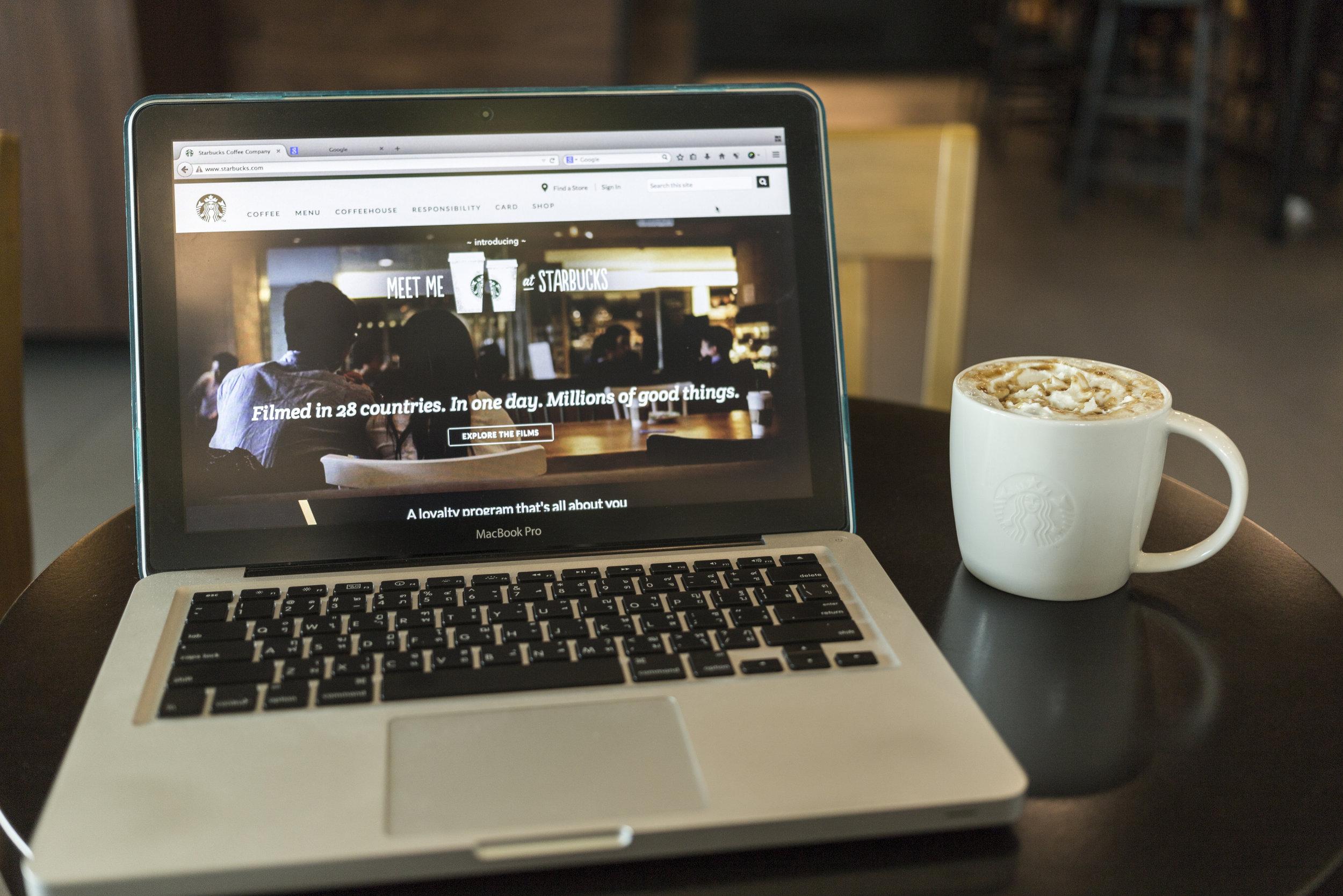 chiang-mai-thailand-october-02-2014-starbucks-coffee-caramel-latte-and-apple-laptop-open-starbucks-website-on-monitor_Sw51XJdhGl.jpg