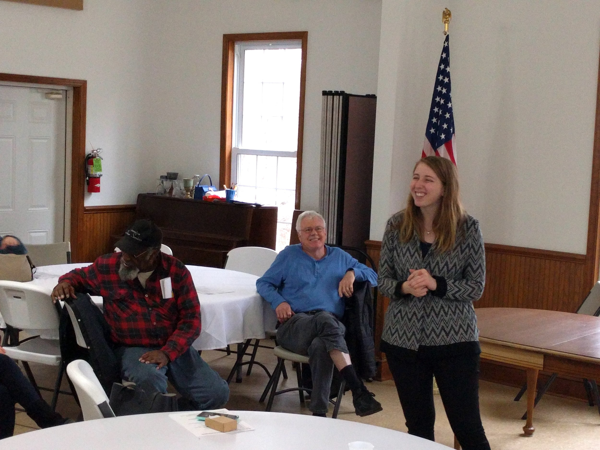Caption: Kristen Powers speaks to group at a local event.