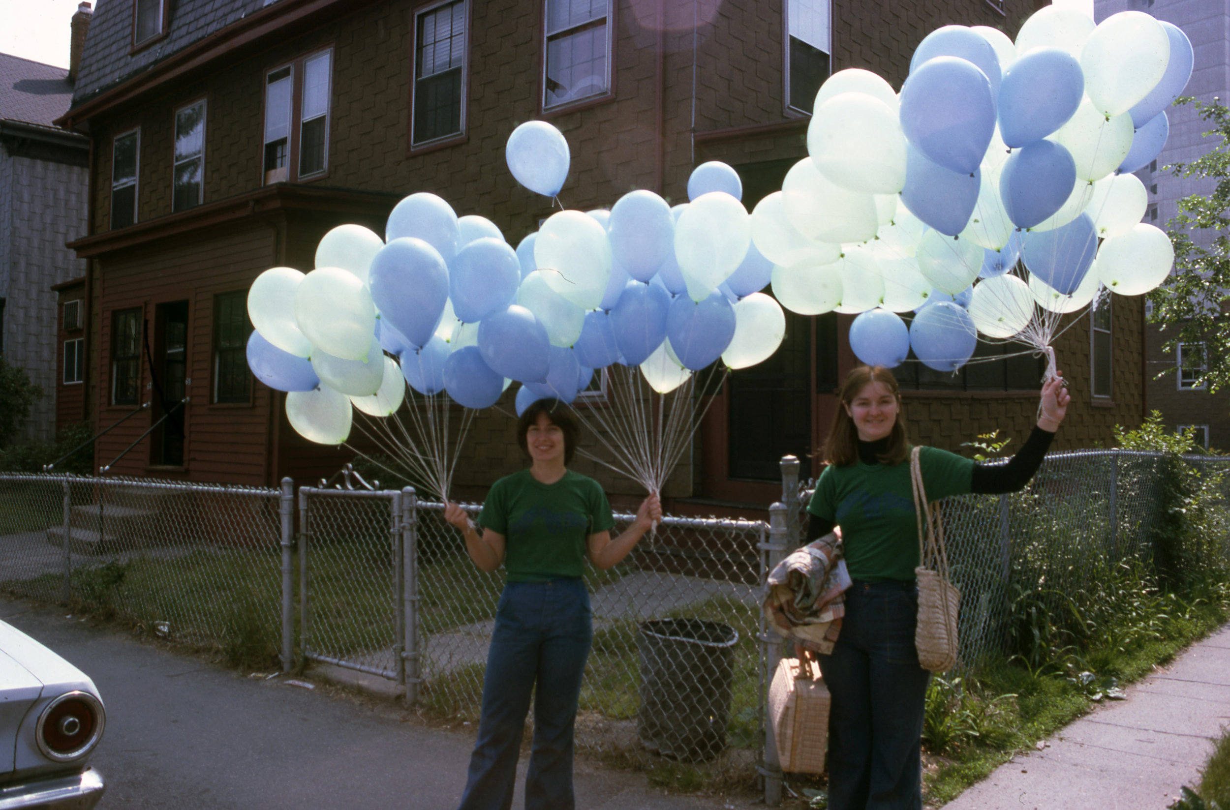 """Monica Hynes-Payack and Mary Shepherd with some of Poet Peter Payack's 5,000 """"Poetry Balloons"""" at the first Cambridge River Festival in 1976. Each balloon was filled with a poem. Poems ranged from Cambridge school children to the nations Poet Laureate, Robert Pinsky."""