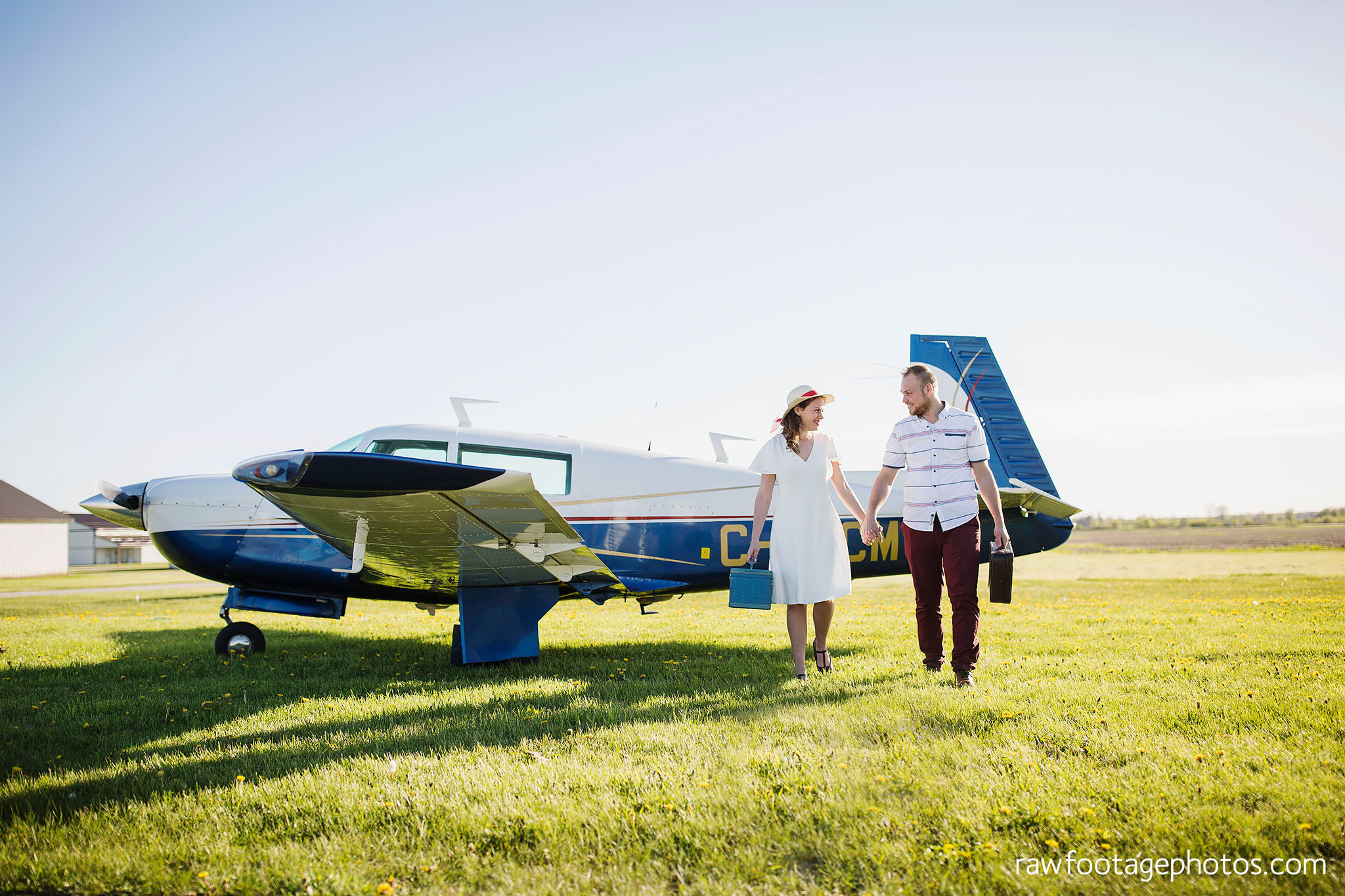 london_ontario_wedding_photographer-raw_footage_photography-engagement_session-airport_session-airplane-balloons-apple_orchard-spring_blooms-apple_blossoms001.jpg