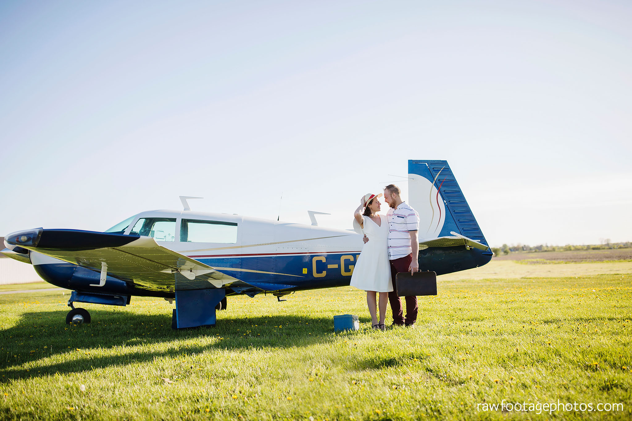 london_ontario_wedding_photographer-raw_footage_photography-engagement_session-airport_session-airplane-balloons-apple_orchard-spring_blooms-apple_blossoms003.jpg