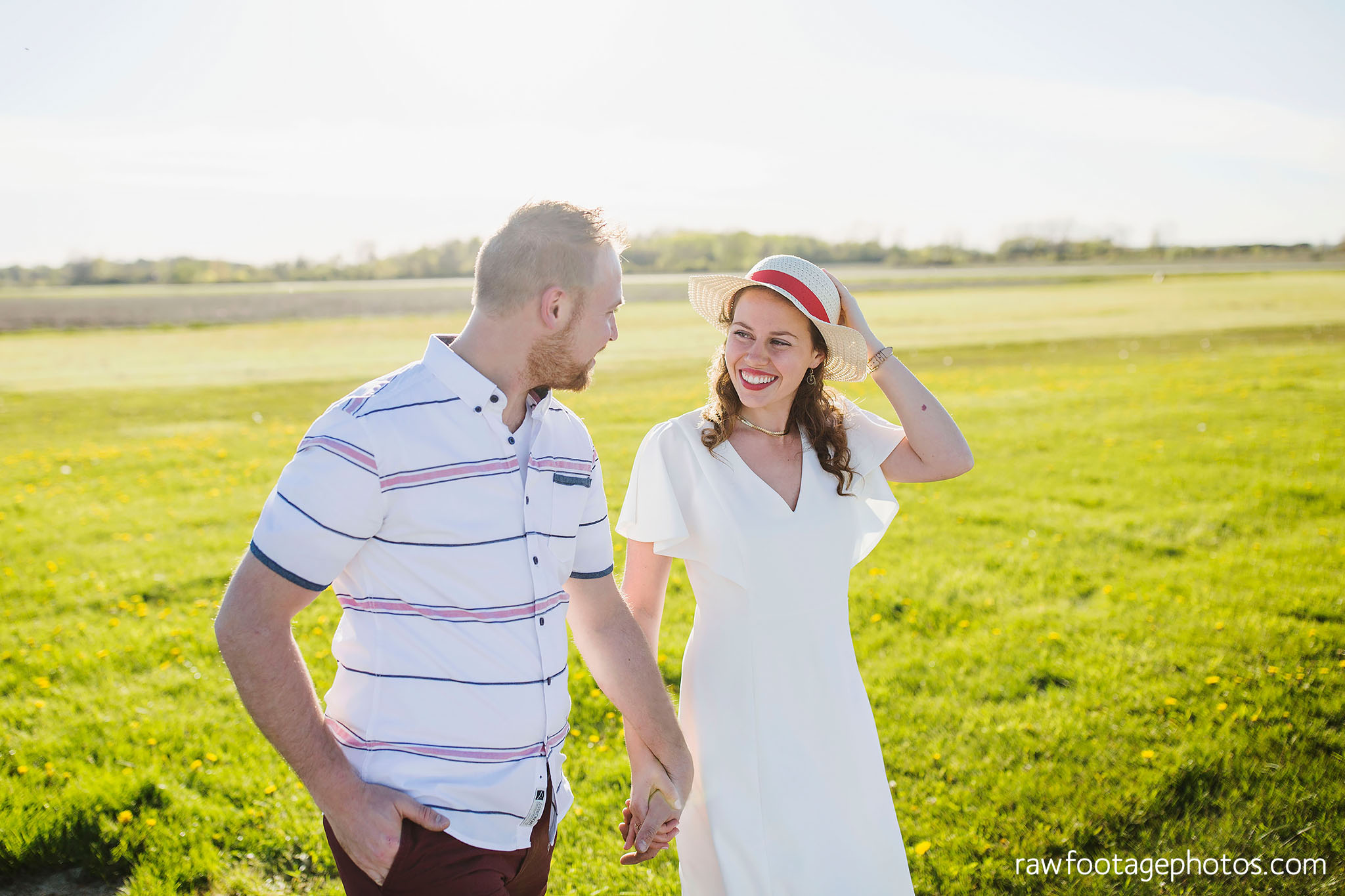 london_ontario_wedding_photographer-raw_footage_photography-engagement_session-airport_session-airplane-balloons-apple_orchard-spring_blooms-apple_blossoms004.jpg