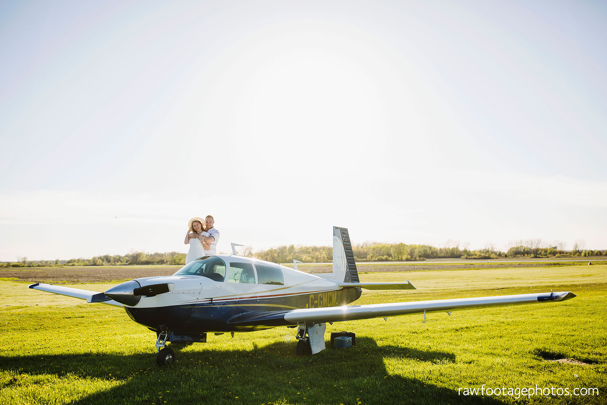 london_ontario_wedding_photographer-raw_footage_photography-engagement_session-airport_session-airplane-balloons-apple_orchard-spring_blooms-apple_blossoms006.jpg