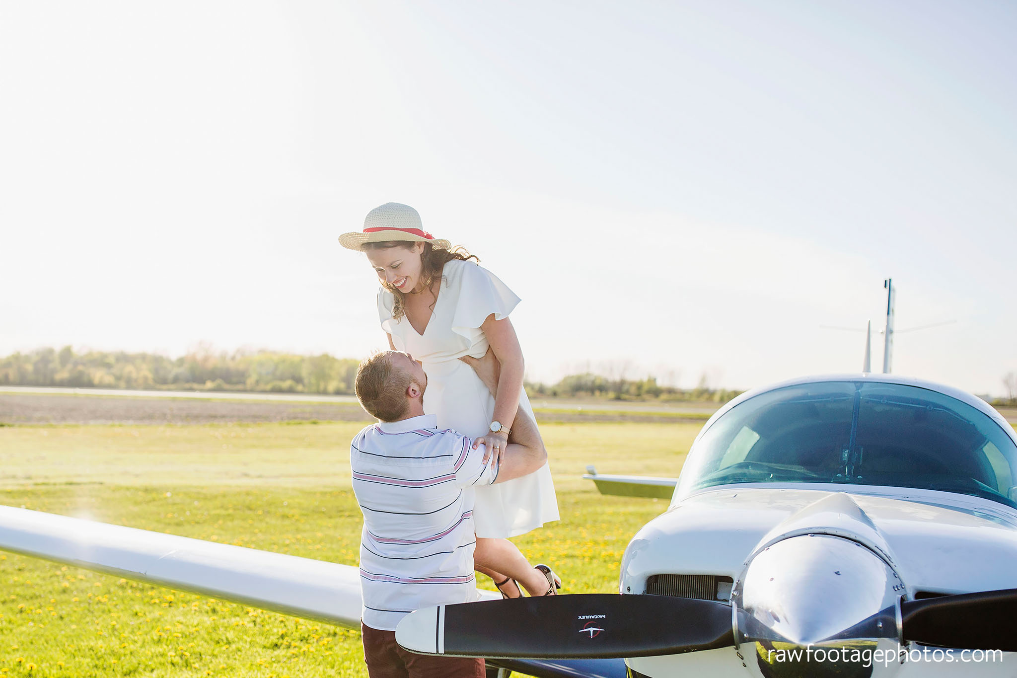 london_ontario_wedding_photographer-raw_footage_photography-engagement_session-airport_session-airplane-balloons-apple_orchard-spring_blooms-apple_blossoms007.jpg