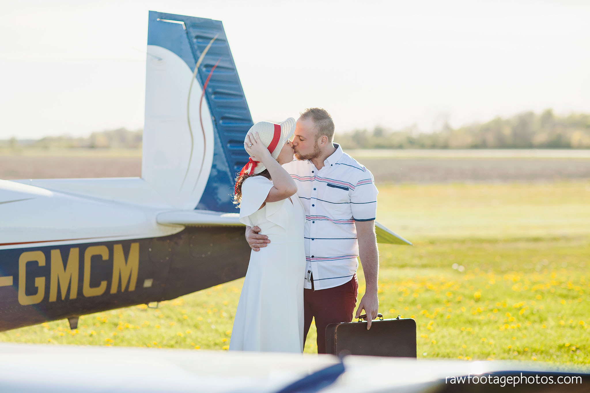 london_ontario_wedding_photographer-raw_footage_photography-engagement_session-airport_session-airplane-balloons-apple_orchard-spring_blooms-apple_blossoms010.jpg