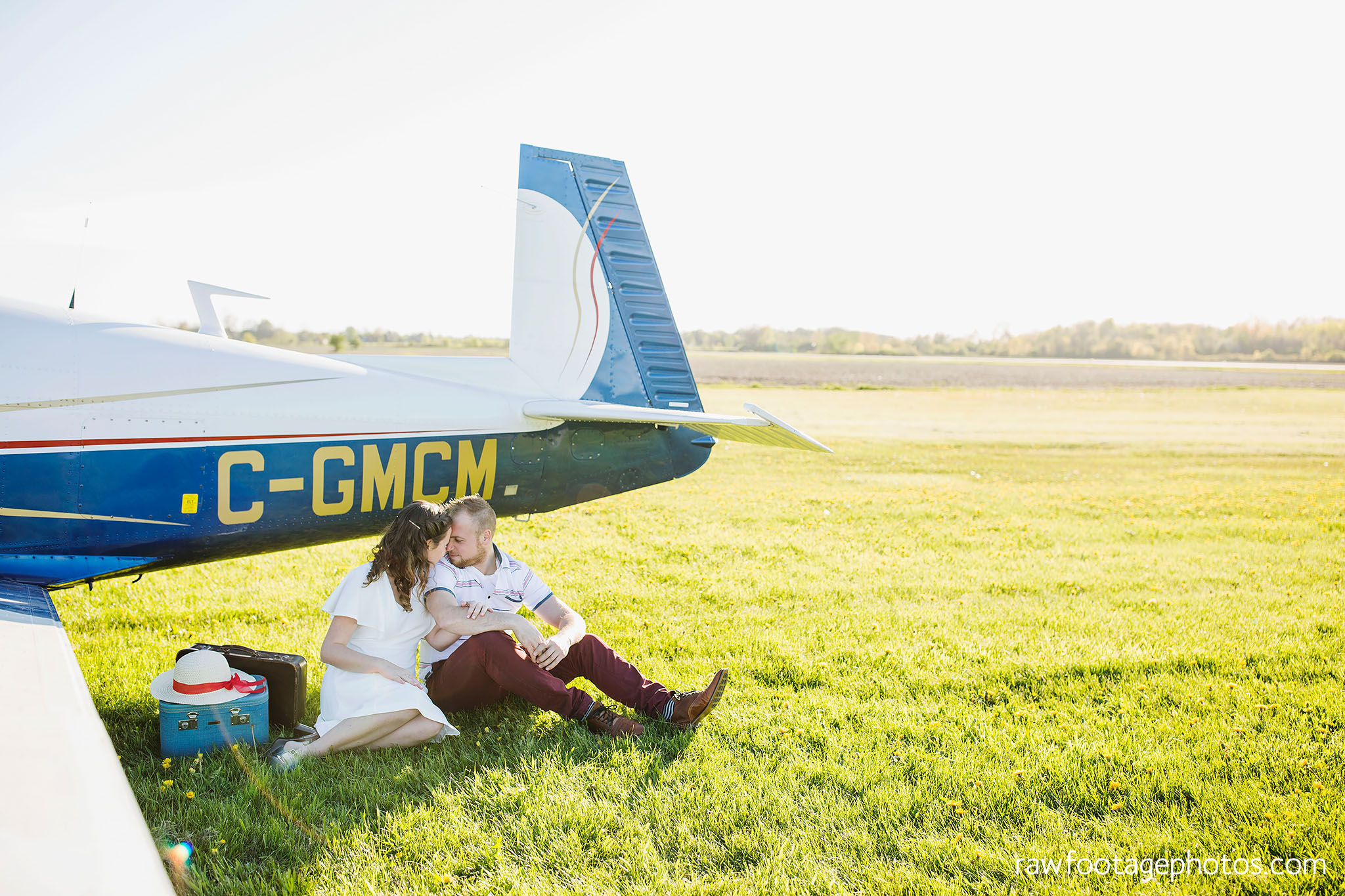 london_ontario_wedding_photographer-raw_footage_photography-engagement_session-airport_session-airplane-balloons-apple_orchard-spring_blooms-apple_blossoms009.jpg