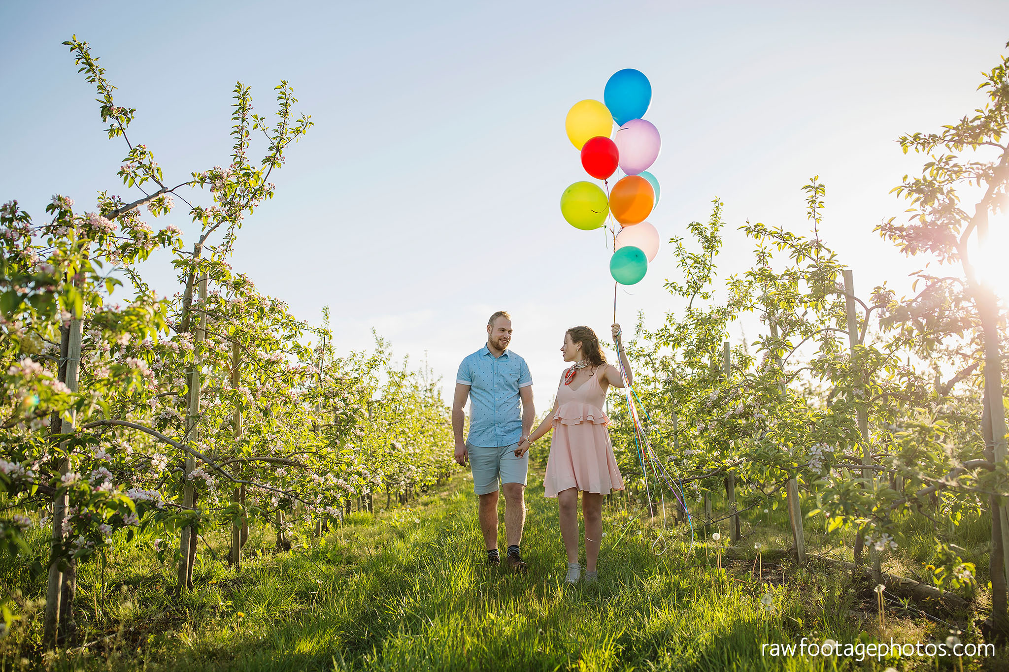 london_ontario_wedding_photographer-raw_footage_photography-engagement_session-airport_session-airplane-balloons-apple_orchard-spring_blooms-apple_blossoms014.jpg