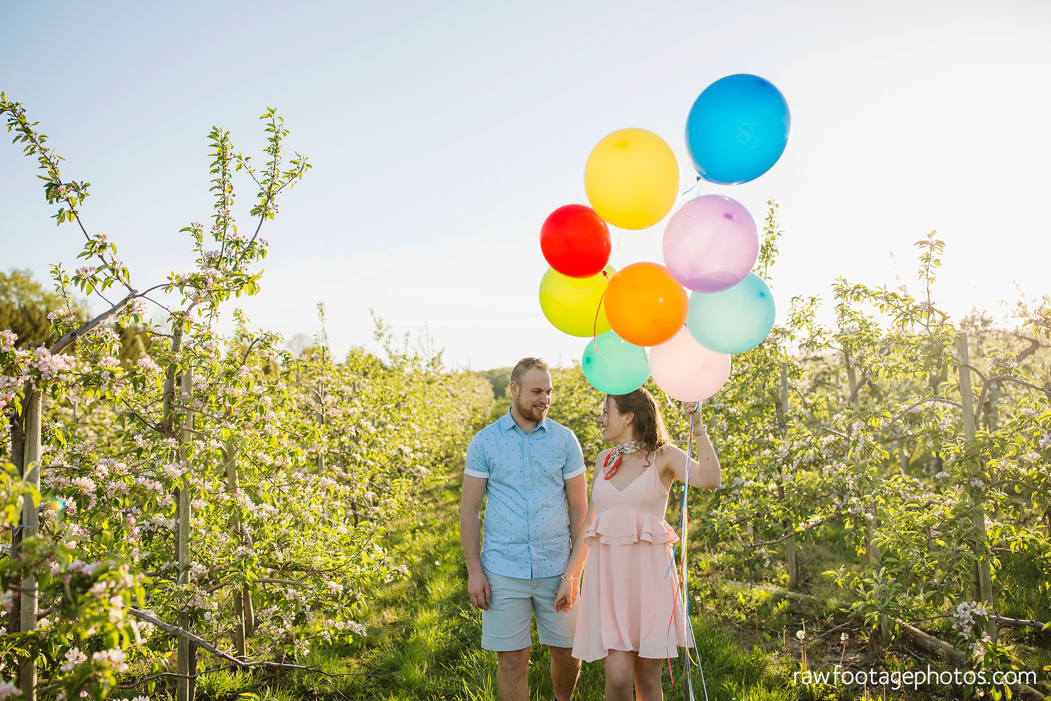 london_ontario_wedding_photographer-raw_footage_photography-engagement_session-airport_session-airplane-balloons-apple_orchard-spring_blooms-apple_blossoms015.jpg