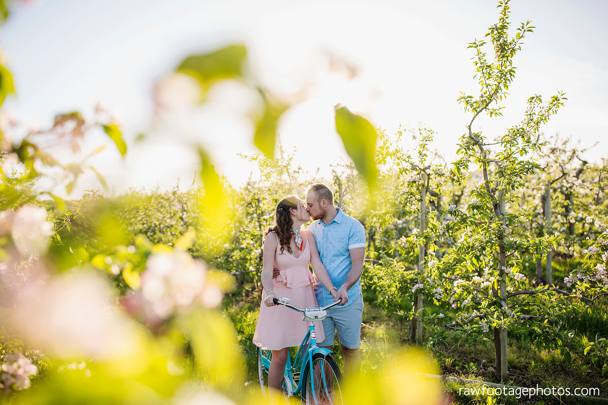 london_ontario_wedding_photographer-raw_footage_photography-engagement_session-airport_session-airplane-balloons-apple_orchard-spring_blooms-apple_blossoms018.jpg