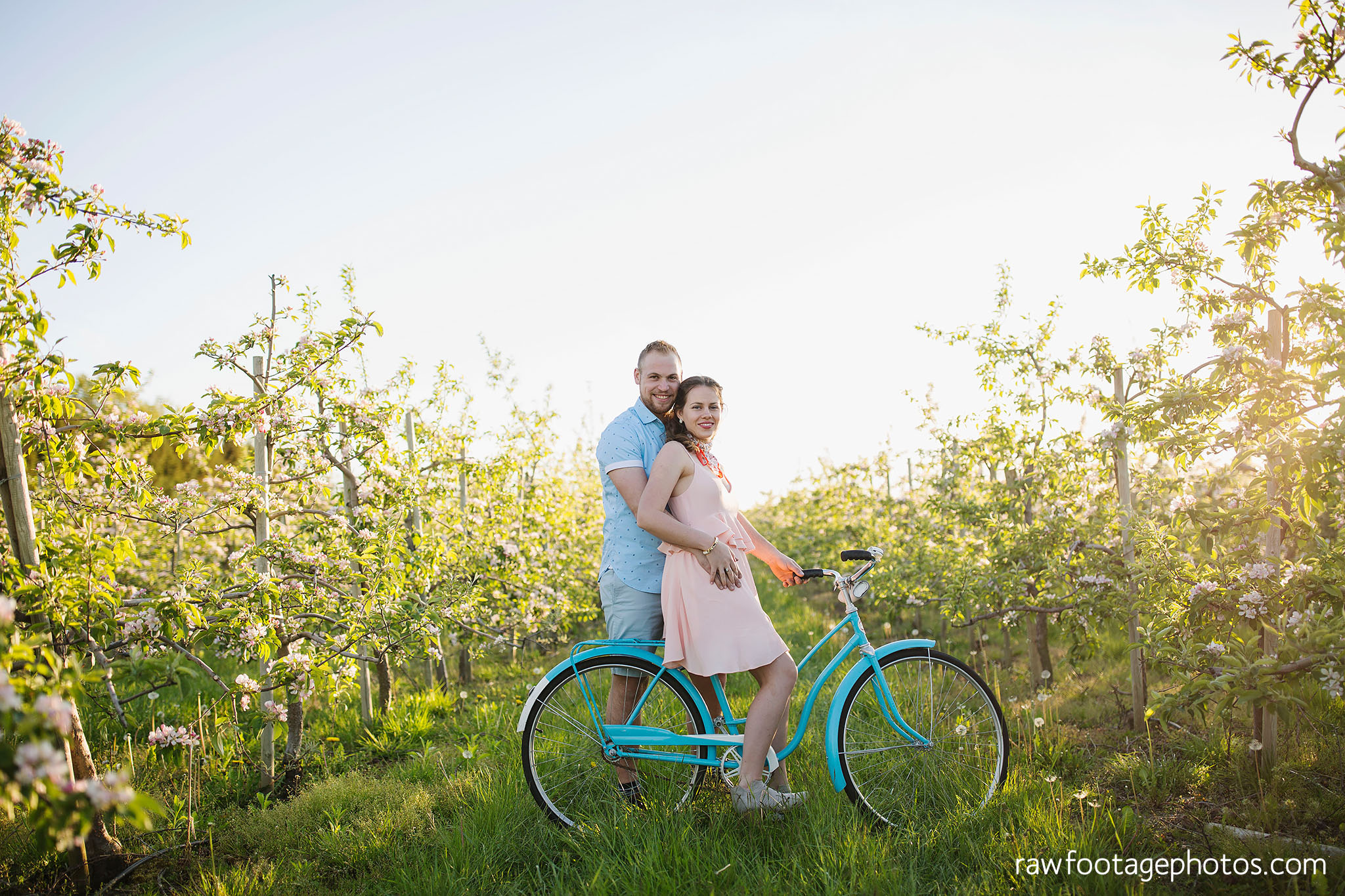 london_ontario_wedding_photographer-raw_footage_photography-engagement_session-airport_session-airplane-balloons-apple_orchard-spring_blooms-apple_blossoms024.jpg