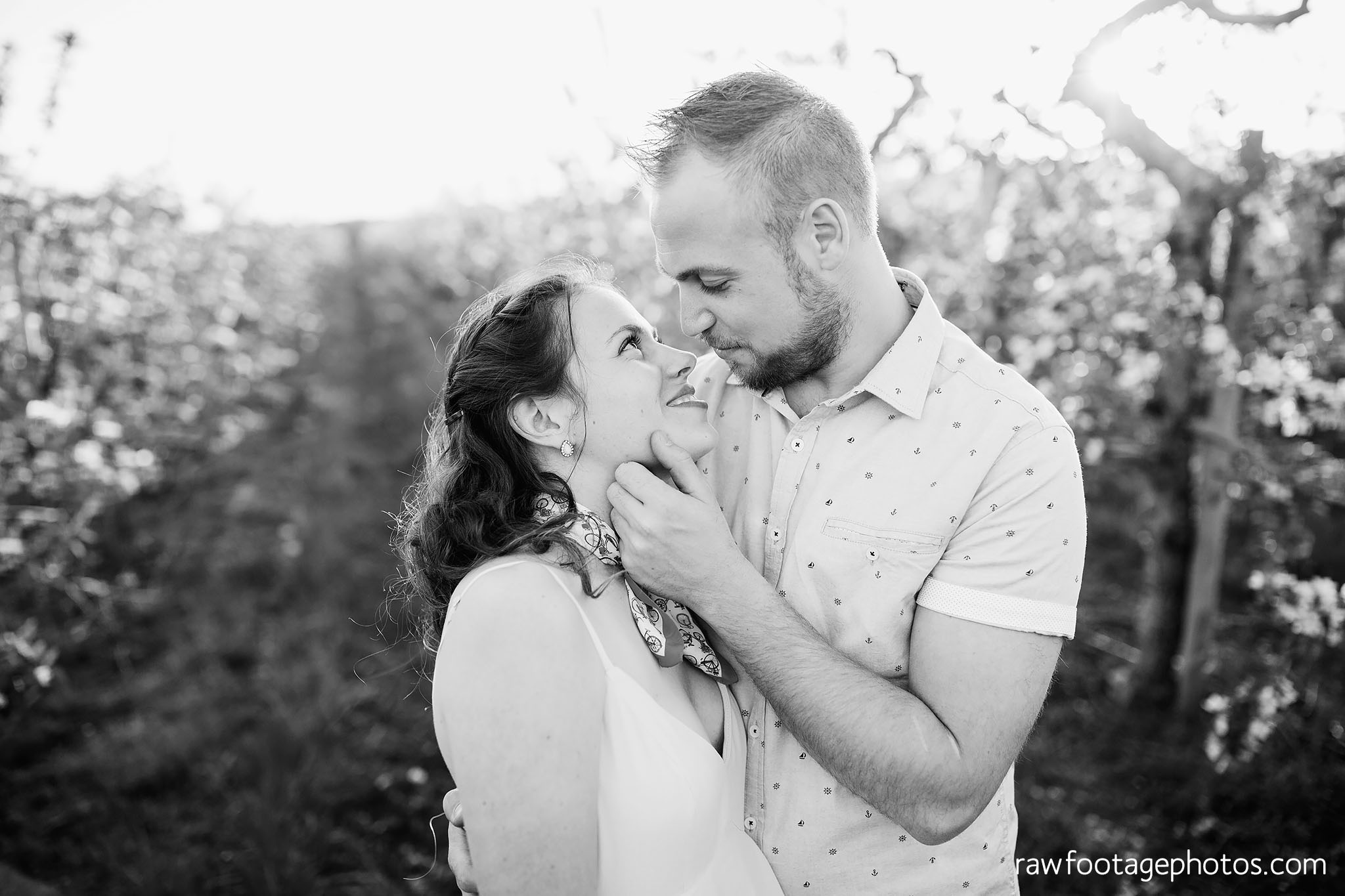london_ontario_wedding_photographer-raw_footage_photography-engagement_session-airport_session-airplane-balloons-apple_orchard-spring_blooms-apple_blossoms029.jpg