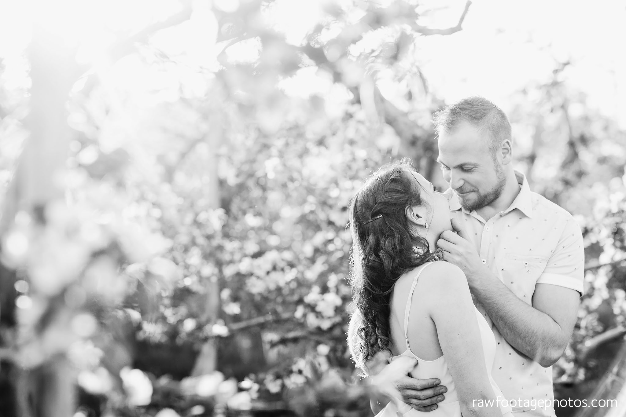 london_ontario_wedding_photographer-raw_footage_photography-engagement_session-airport_session-airplane-balloons-apple_orchard-spring_blooms-apple_blossoms036.jpg