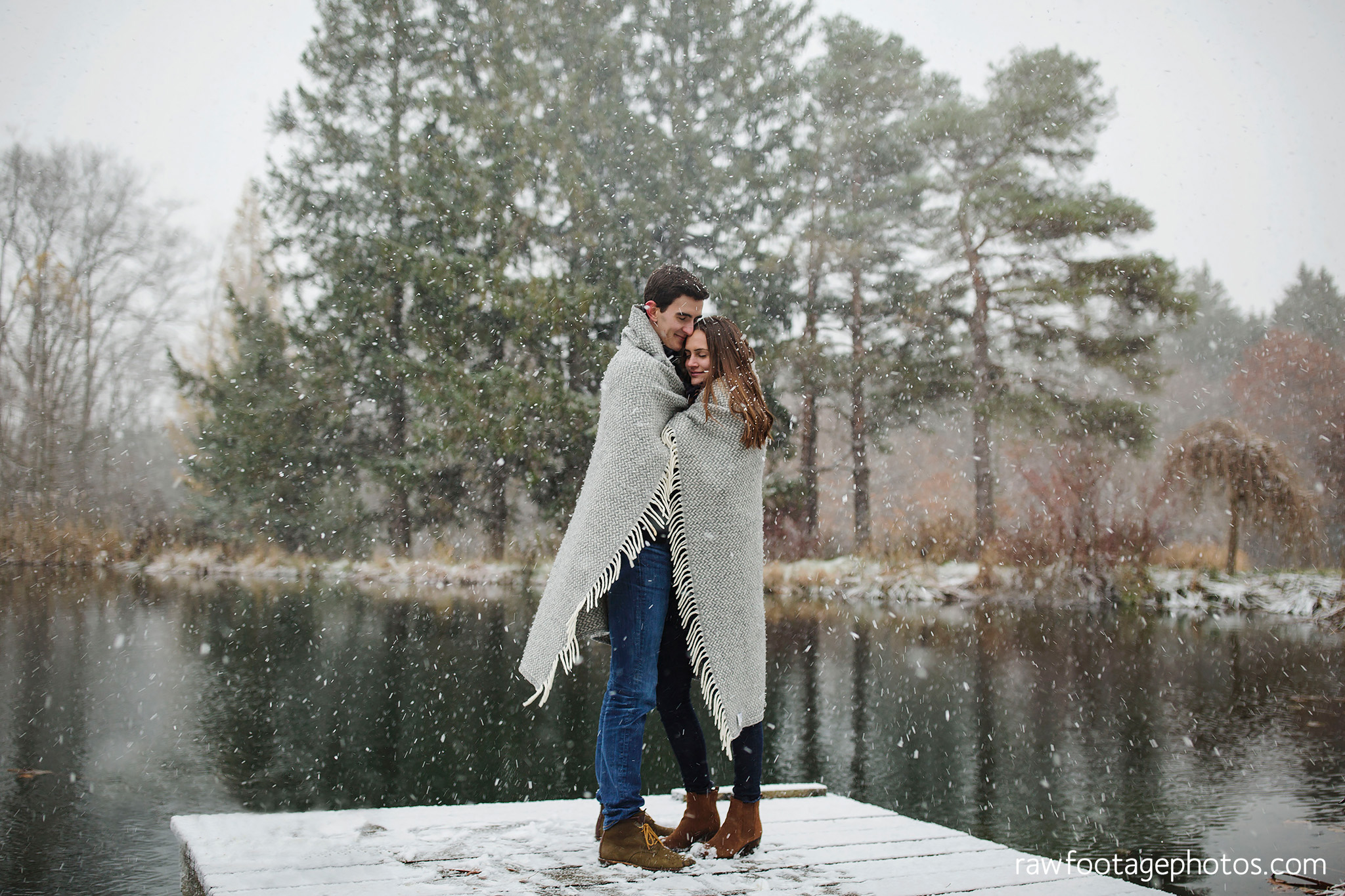 london_ontario_wedding_photographer-snowy_engagement_session-winter-barn-farm-snowflakes-blizzard-raw_footage_photography011.jpg